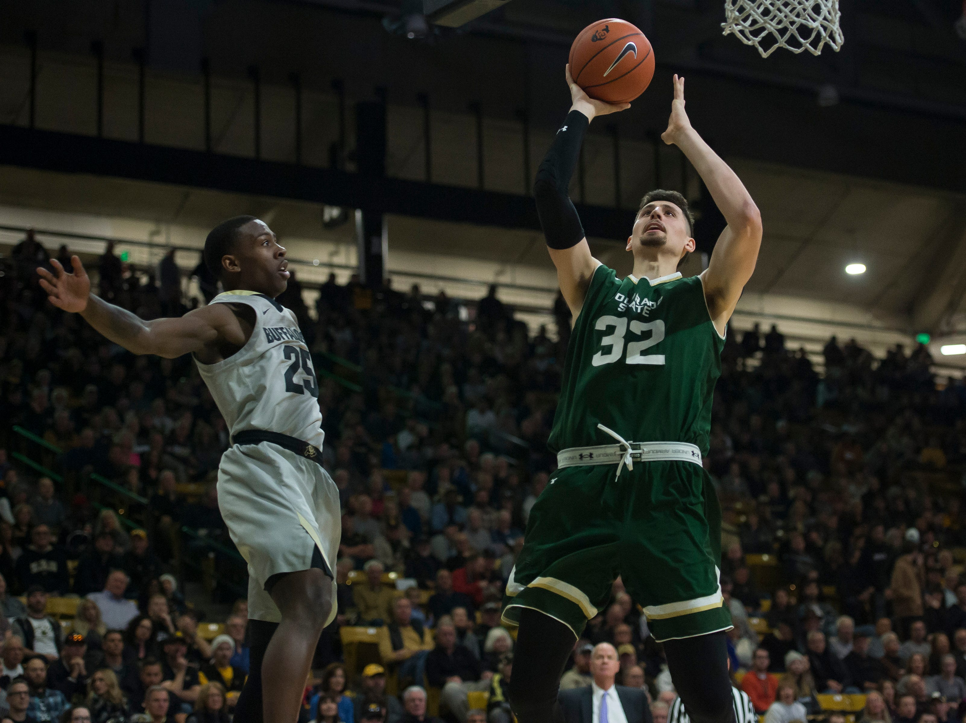 Colorado State University junior forward Nico Carvacho (32) goes for a layup during a game against the University of Colorado on Saturday, Dec. 1, 2018, at the CU Event Center in Boulder, Colo.