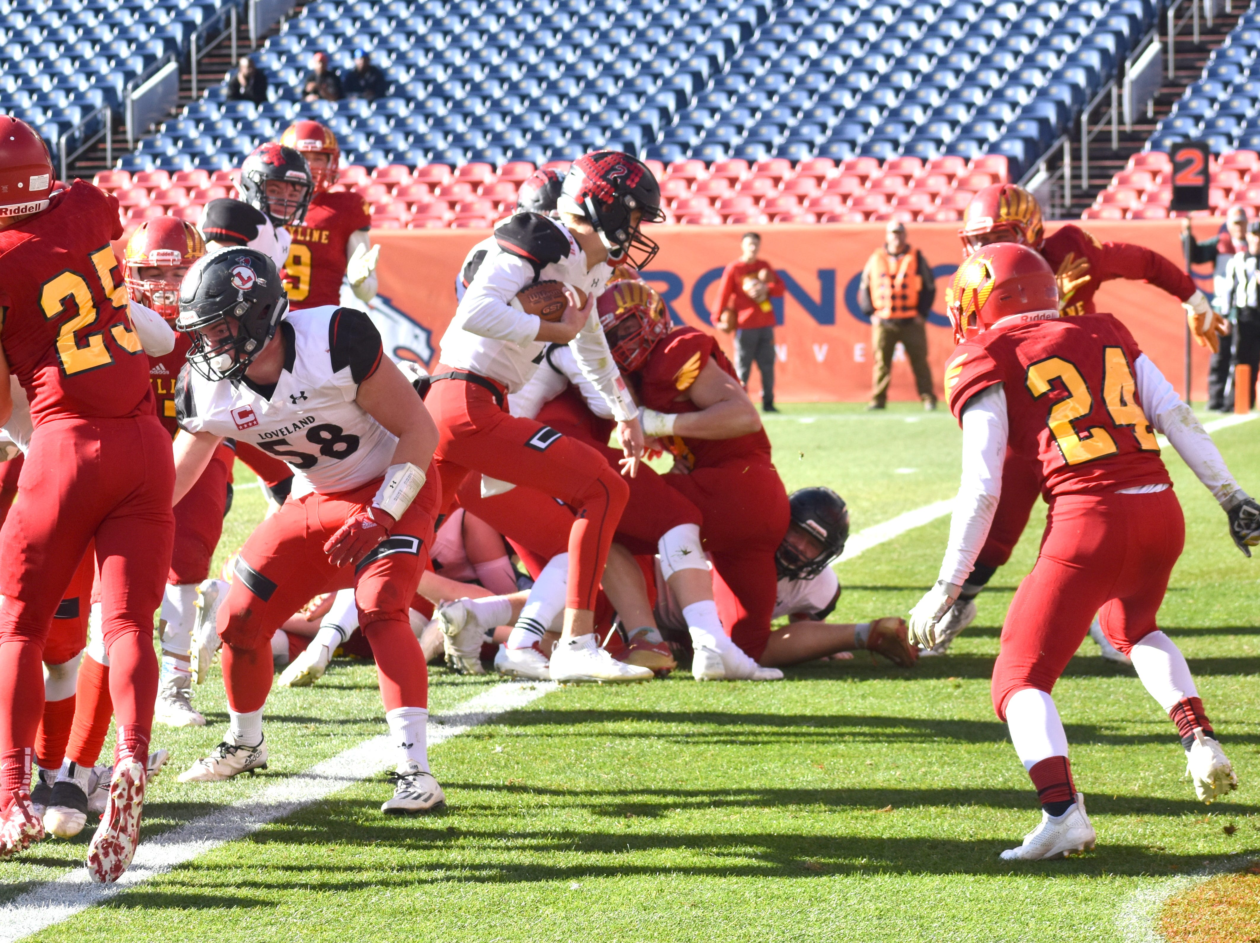 Loveland quarterback Ryan Kinney runs into the end zone for one of his five touchdowns during Saturday's Class 4A state championship game at Broncos Stadium at Mile High in Denver.