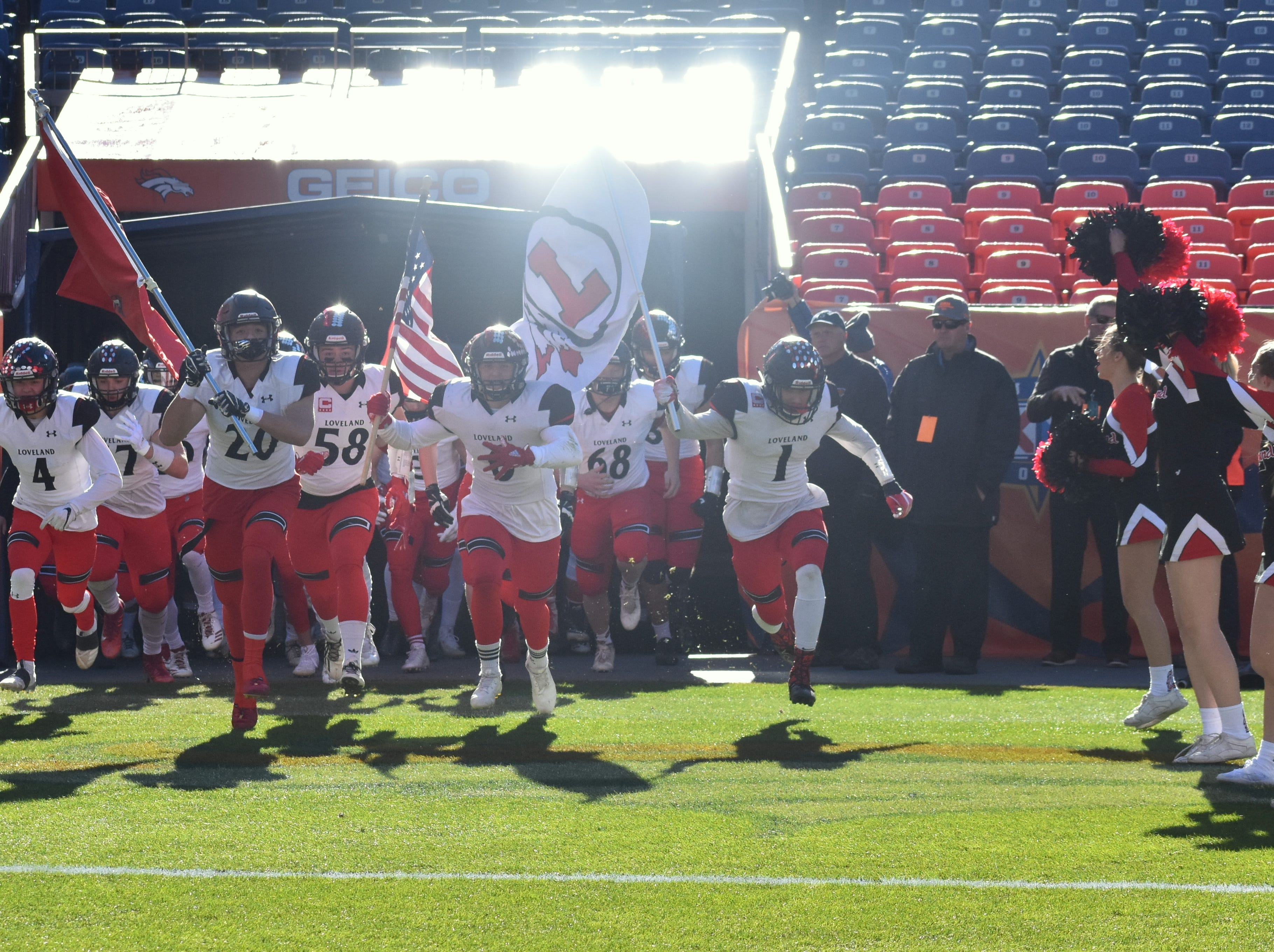 Loveland High School's football team takes the field Saturday for the Class 4A state title game at Broncos Stadium at Mile High.