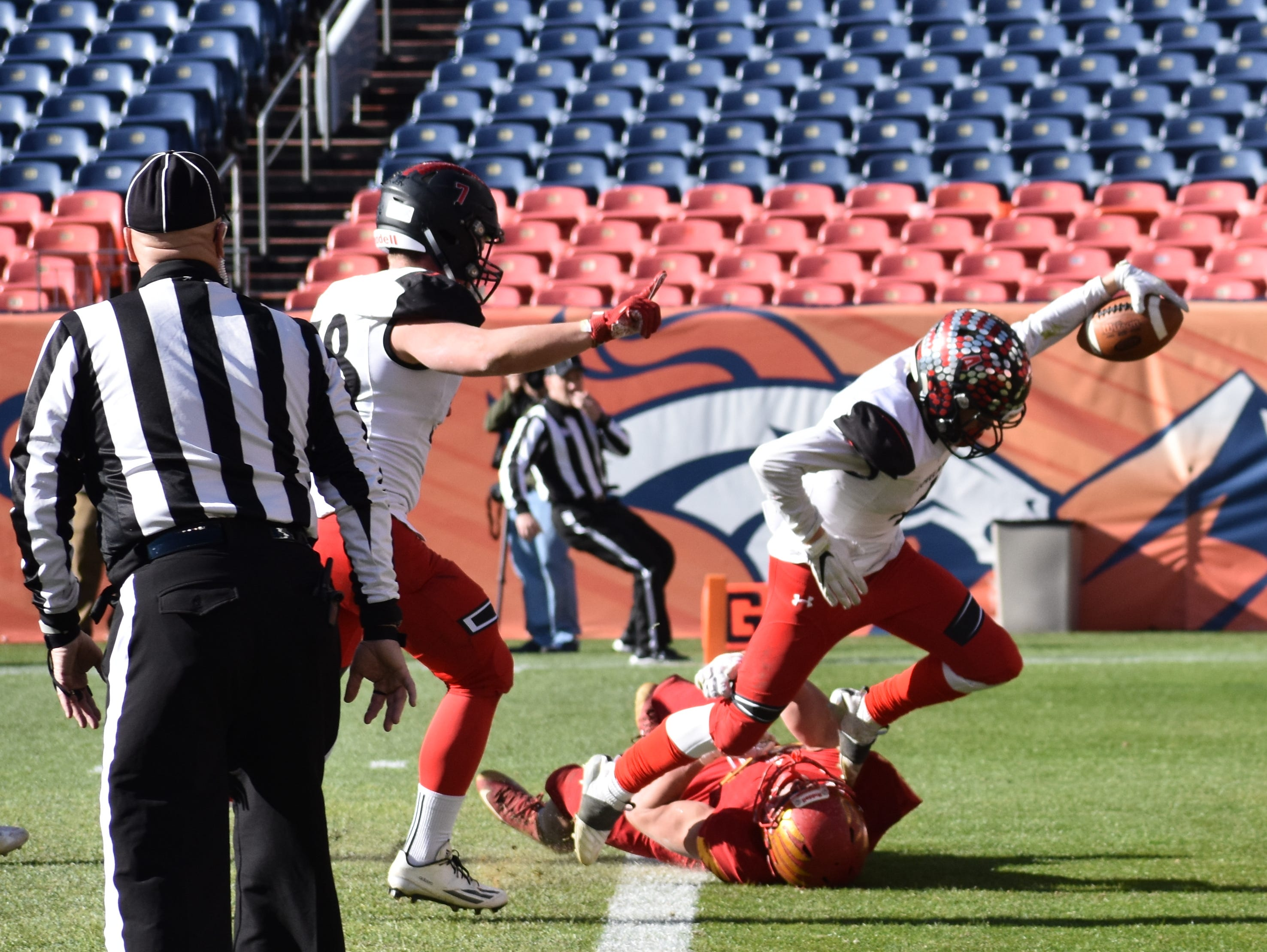 Loveland High football player Cody Rakowsky runs into the end zone for a touchdown during Saturday's Class 4A state championship game in Denver.