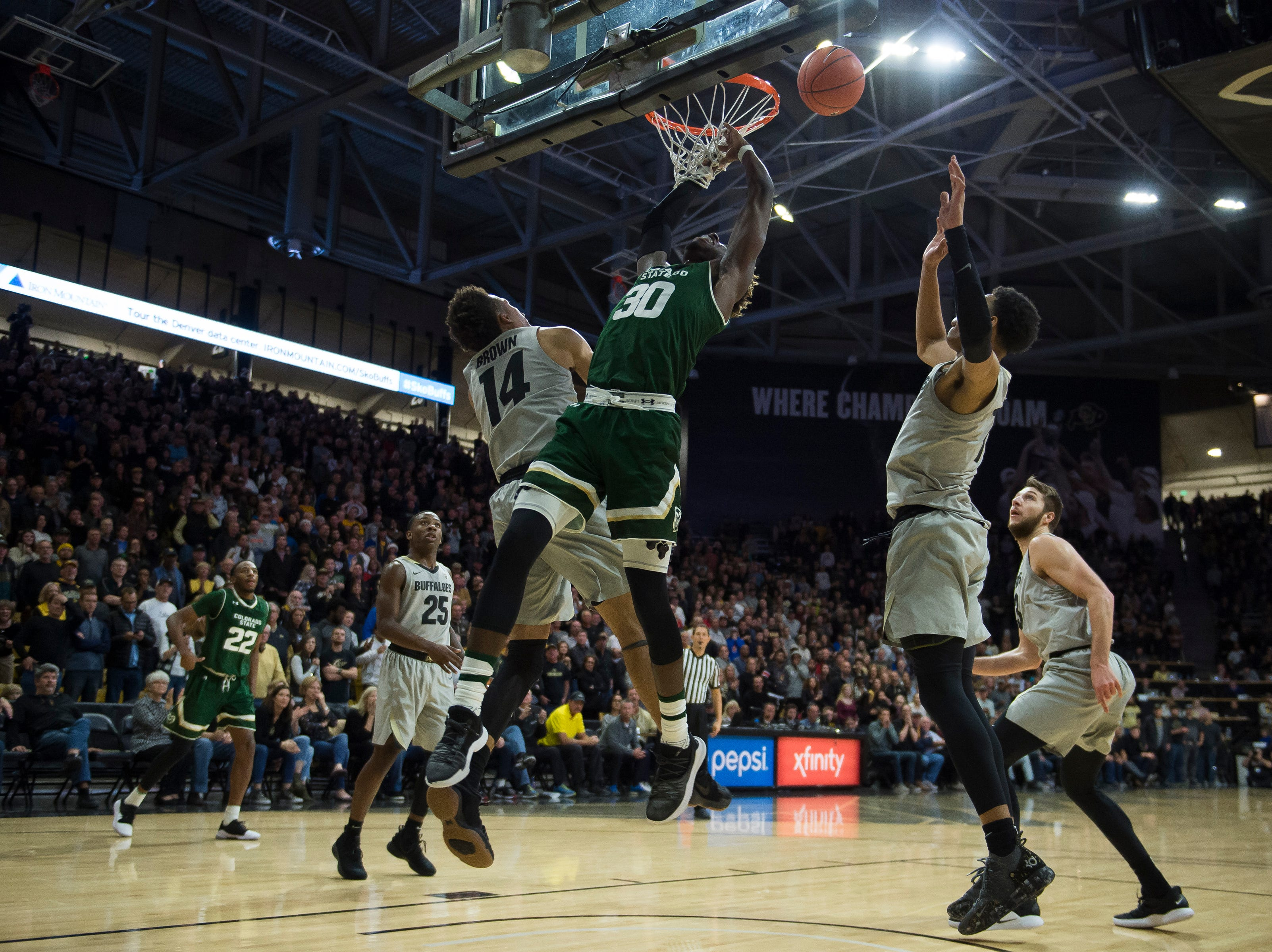 Colorado State University junior guard Kris Martin (30) misses a dunk and is fouled during a game against the University of Colorado on Saturday, Dec. 1, 2018, at the CU Event Center in Boulder, Colo.