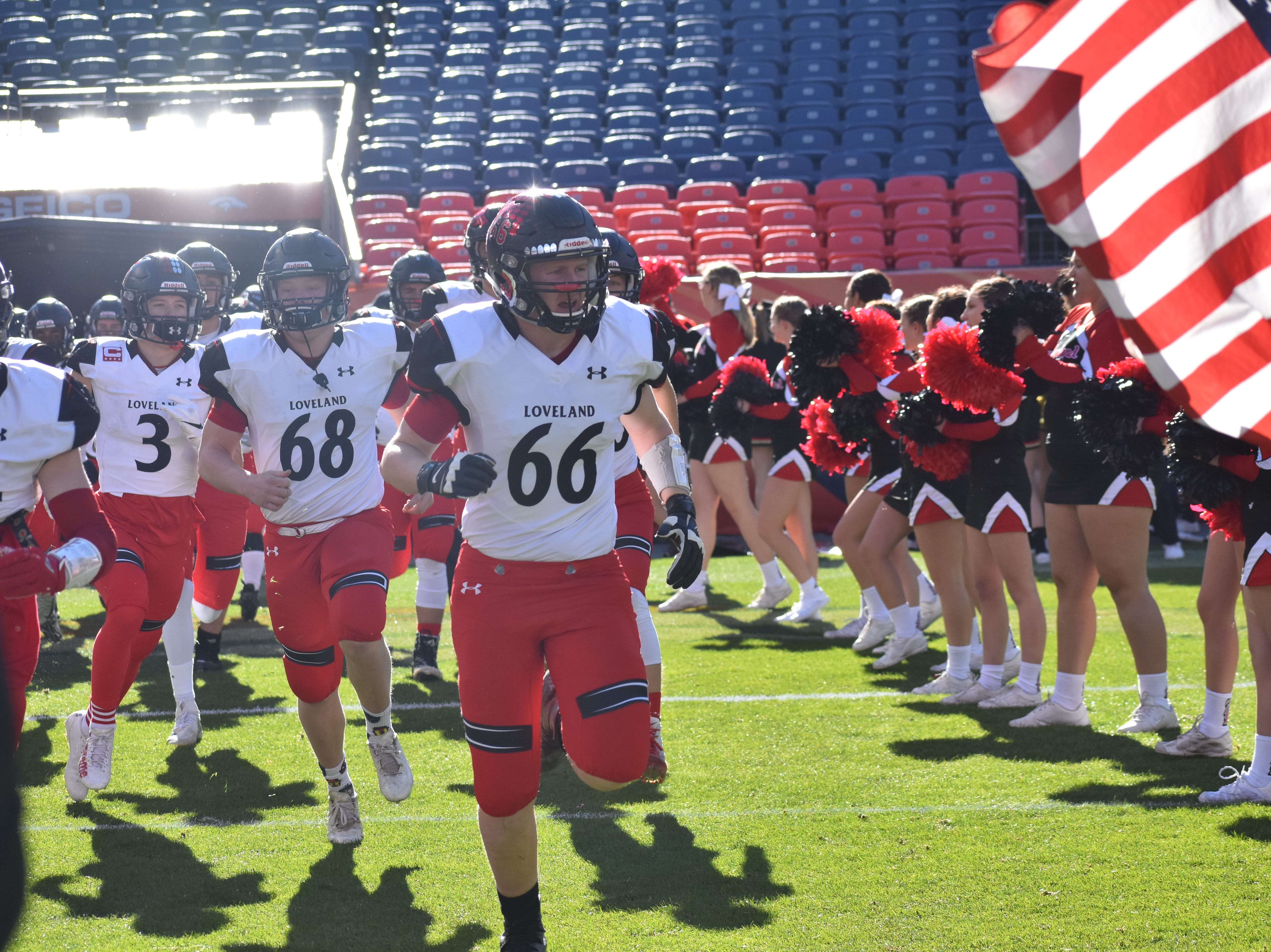 Loveland High football players take the field Saturday before the Class 4A state championship game at Broncos Stadium at Mile High in Denver.