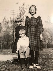 Chuck Kavalec (center) when he was four years old.
