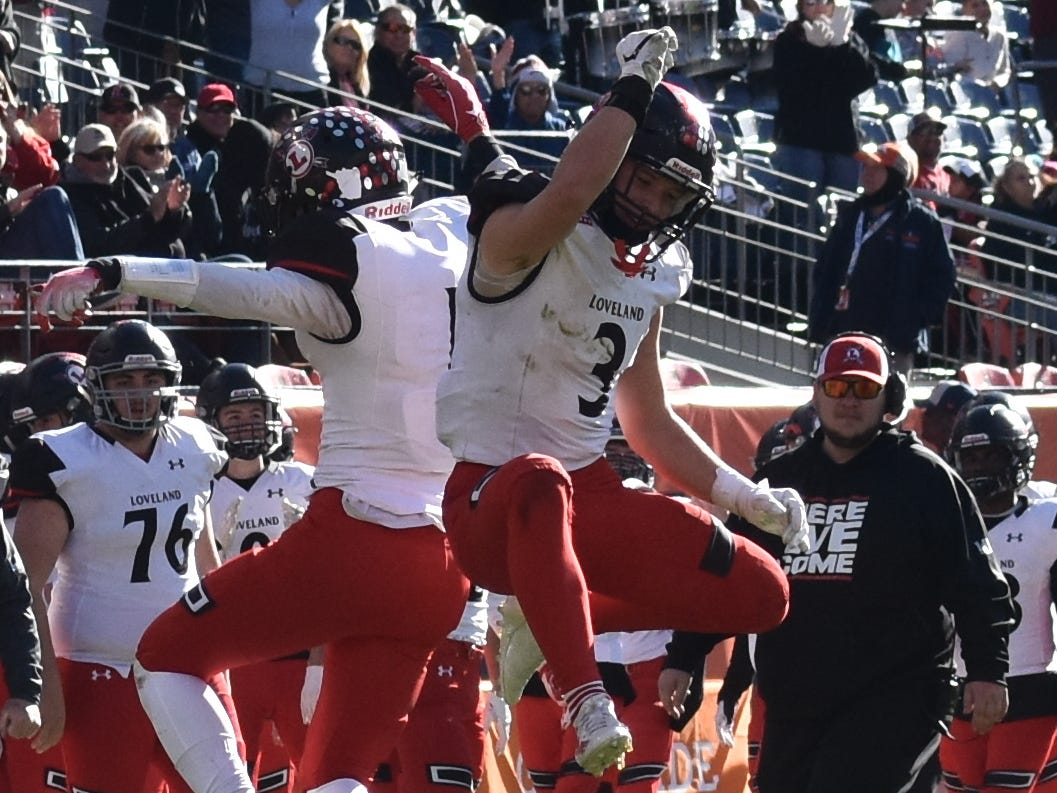 Loveland High School football players celebrate a touchdown during Saturday's Class 4A state title game in Denver.