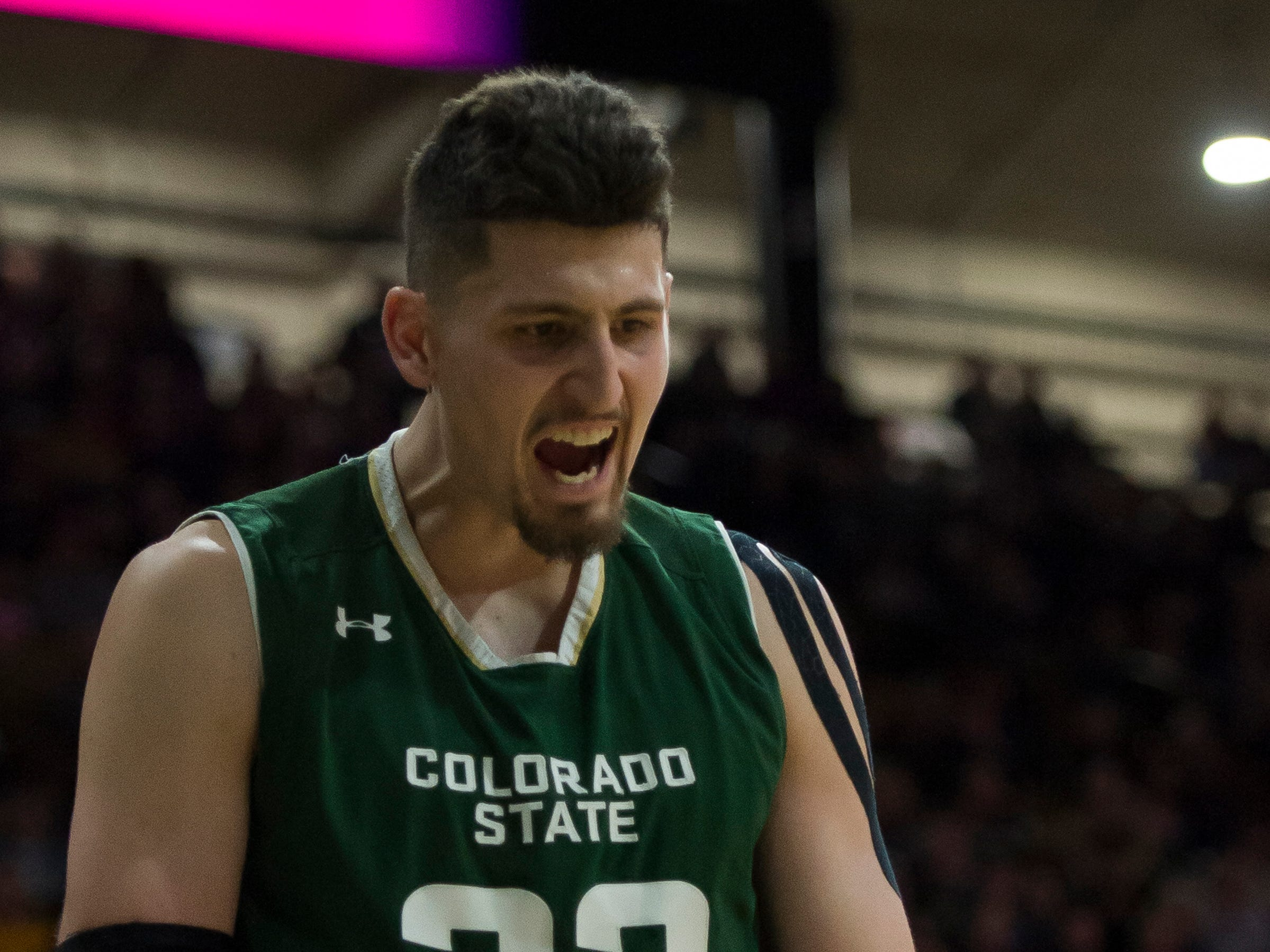 Colorado State University junior center Nico Carvacho (32) reacts after sinking a layup during a game against the University of Colorado on Saturday, Dec. 1, 2018, at the CU Event Center in Boulder, Colo.