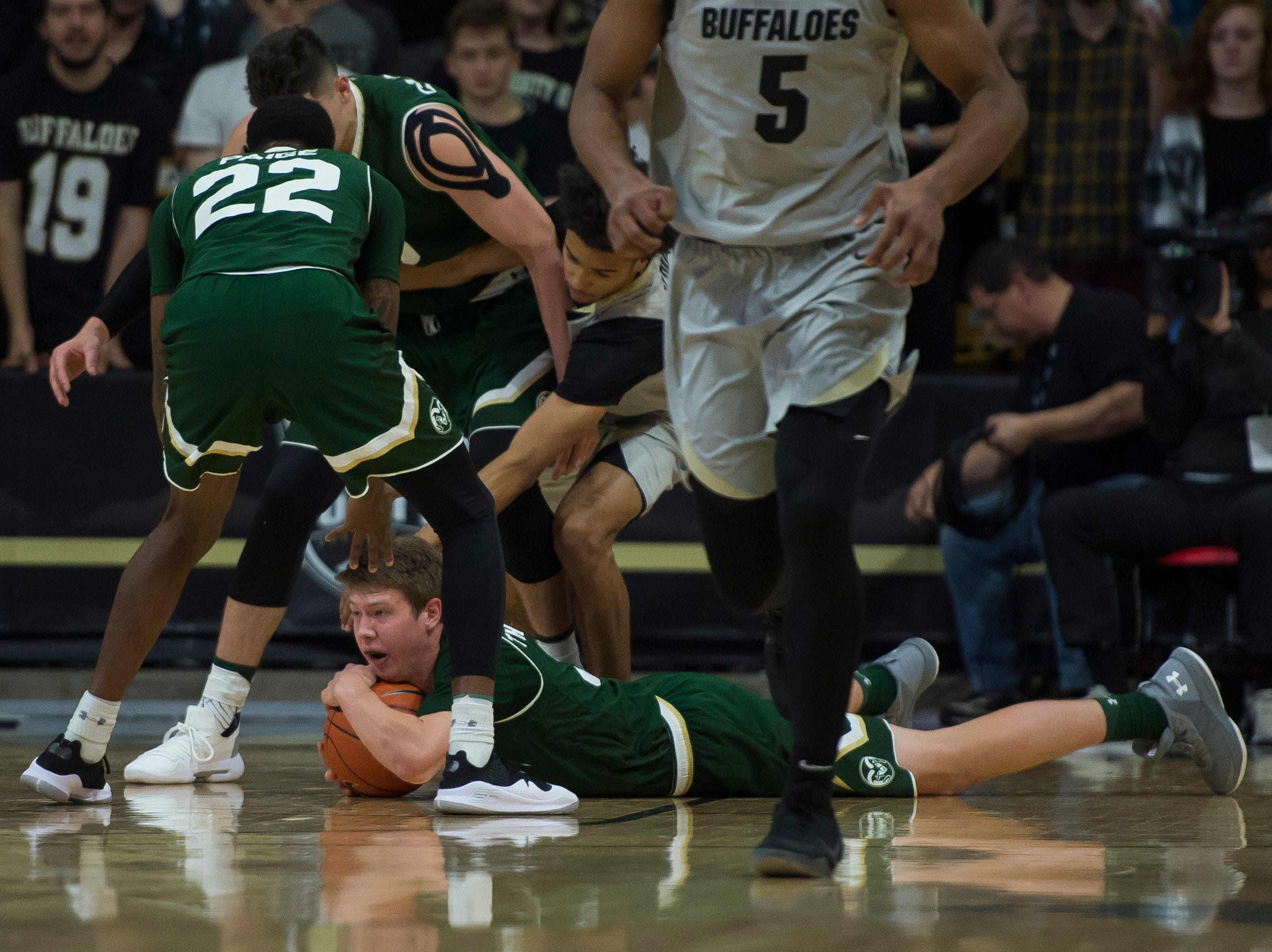 Colorado State University freshman forward Adam Thistlewood (31) jumps on a loose ball during a game against the University of Colorado on Saturday, Dec. 1, 2018, at the CU Event Center in Boulder, Colo.