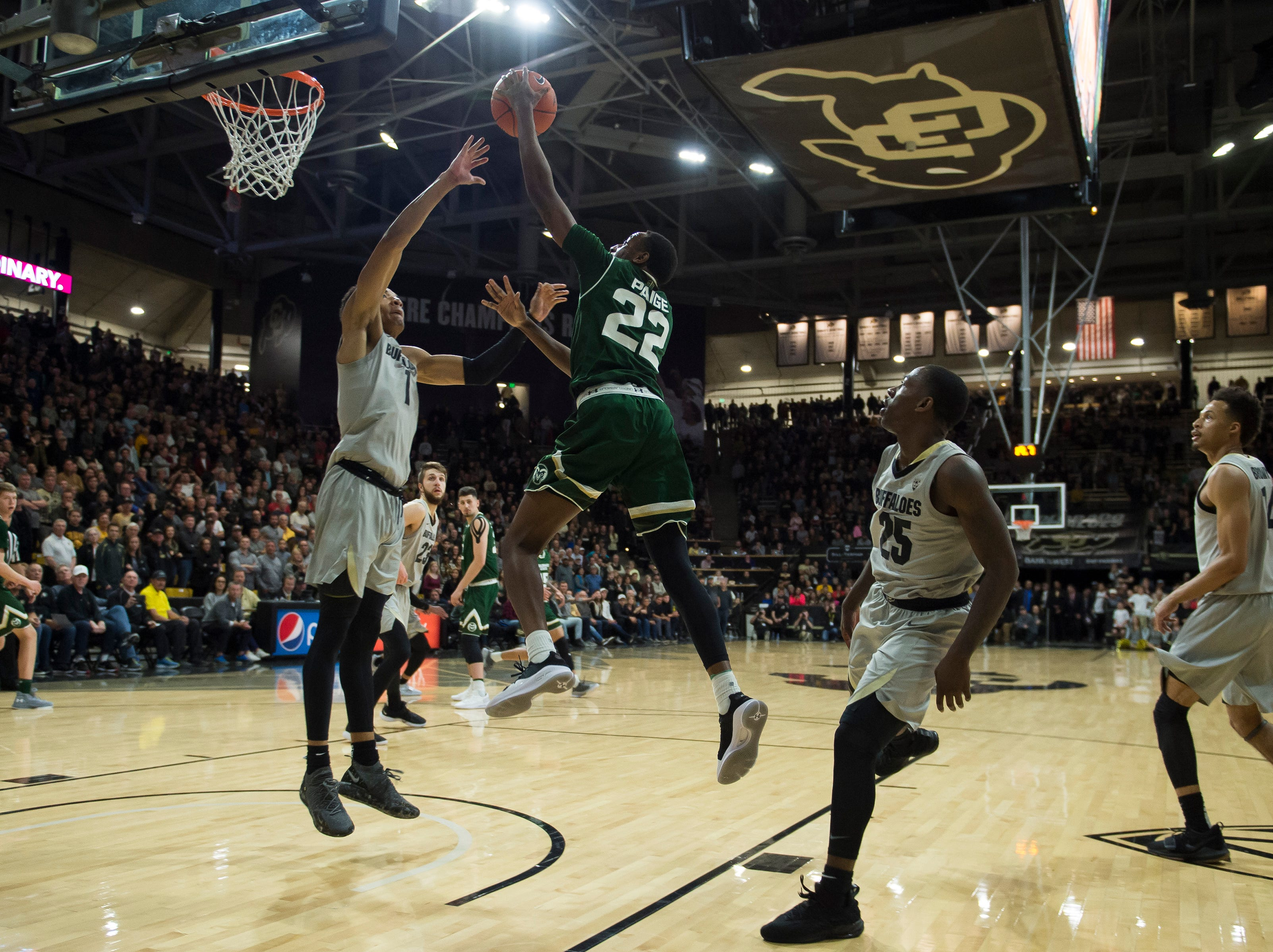Colorado State University senior guard J.D. Paige (22) has his shot blocked by University of Colorado sophomore guard Tyler Bey (1) late in the game on Saturday, Dec. 1, 2018, at the CU Event Center in Boulder, Colo.