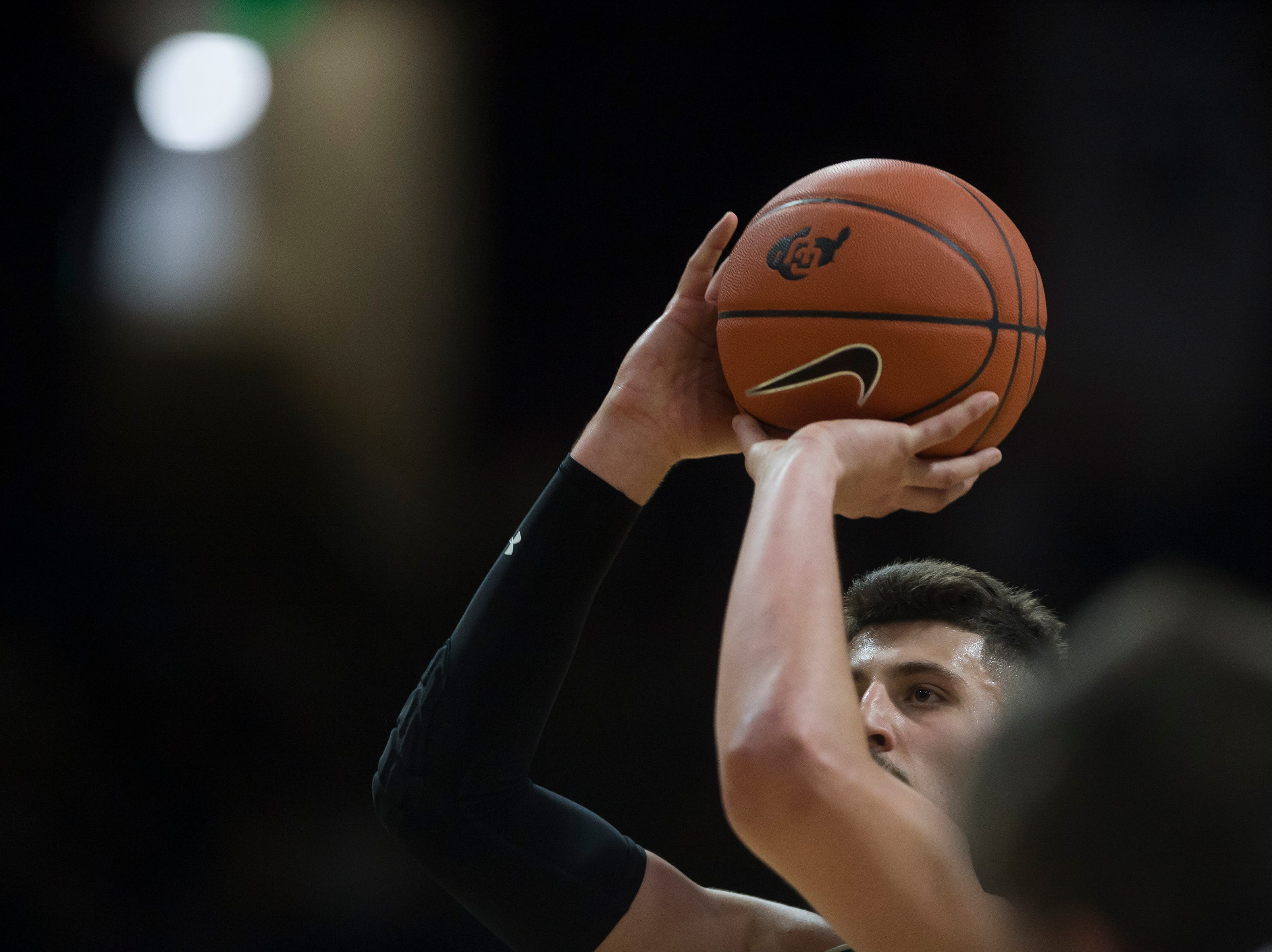Colorado State University junior forward Nico Carvacho (32) attempts a free throw during a game against the University of Colorado on Saturday, Dec. 1, 2018, at the CU Event Center in Boulder, Colo.