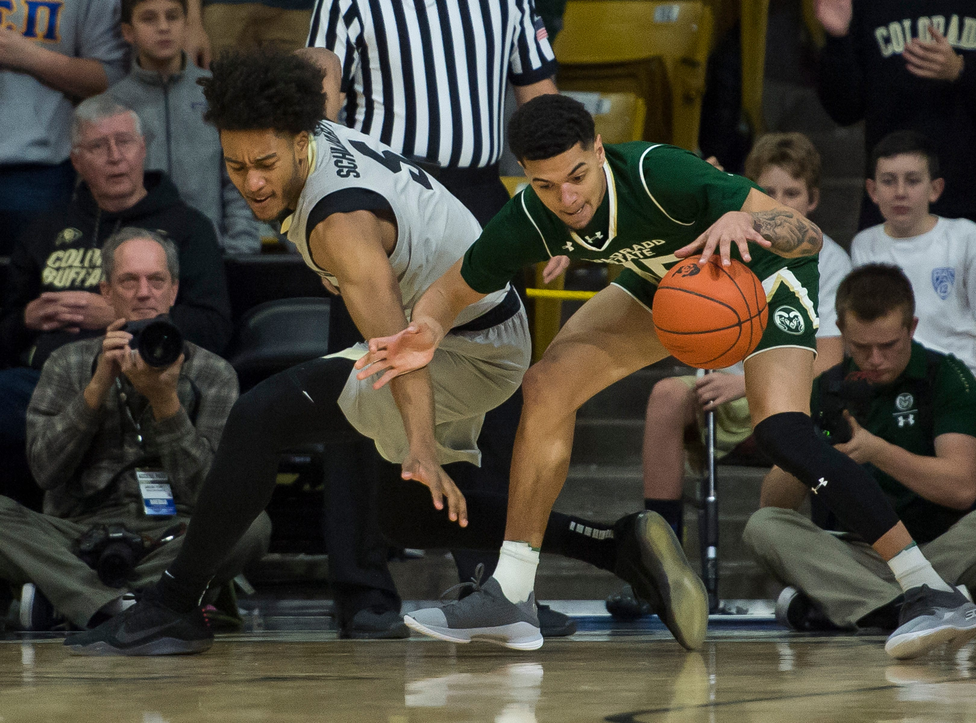Colorado State University junior guard Anthony Masinton-Bonner (15) steals the ball from University of Colorado sophomore guard D'Shawn Schwartz (5) on Saturday, Dec. 1, 2018, at the CU Event Center in Boulder, Colo.