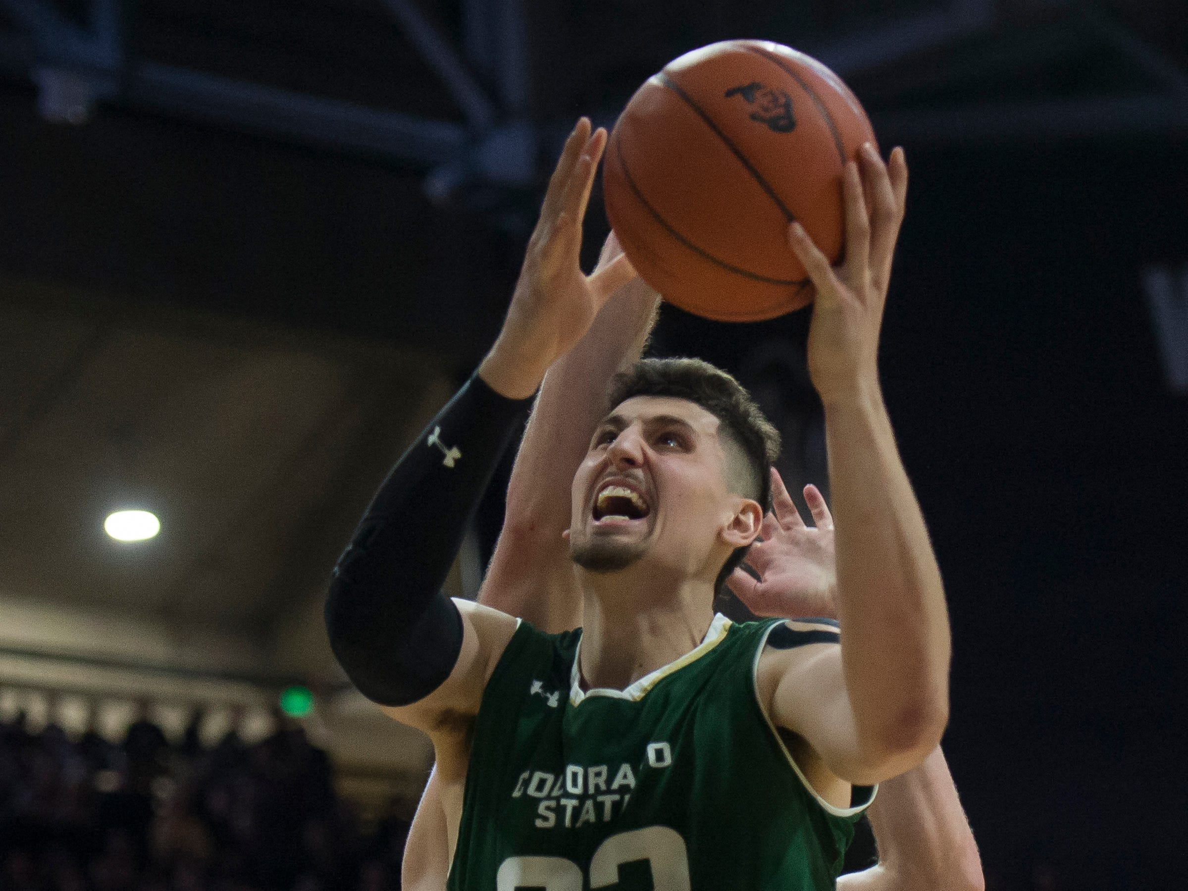 Colorado State University junior center Nico Carvacho (32) puts a shot up during a game against the University of Colorado on Saturday, Dec. 1, 2018, at the CU Event Center in Boulder, Colo.