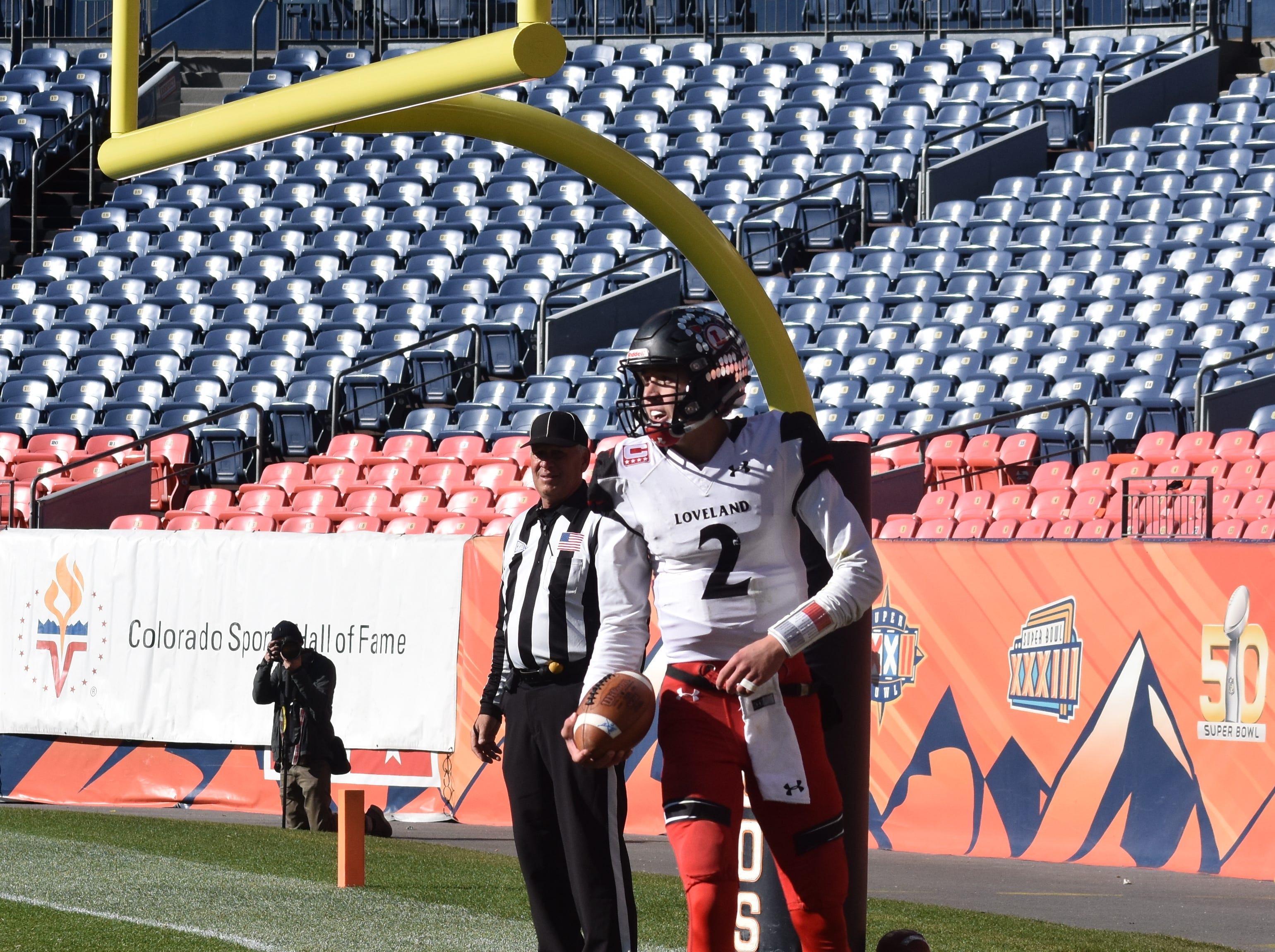 Loveland High quarterback Ryan Kinney stands in the back of the end zone after the third of his five touchdown runs in Saturday's Class 4A state championship game in Denver. Kinney was named the game's MVP.