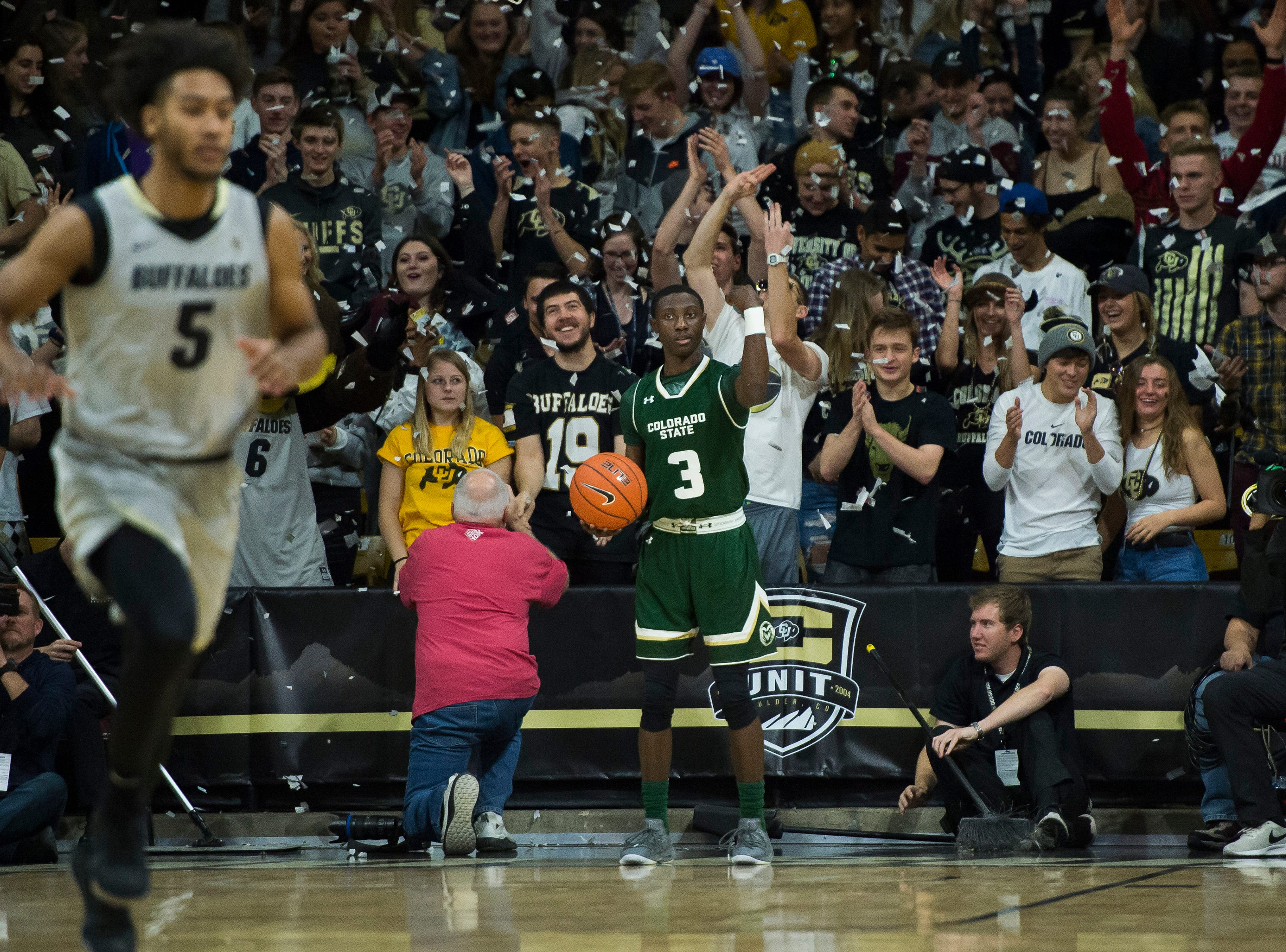 Confetti falls after the University of Colorado scores the opening pinots against Colorado State University on Saturday, Dec. 1, 2018, at the CU Event Center in Boulder, Colo.