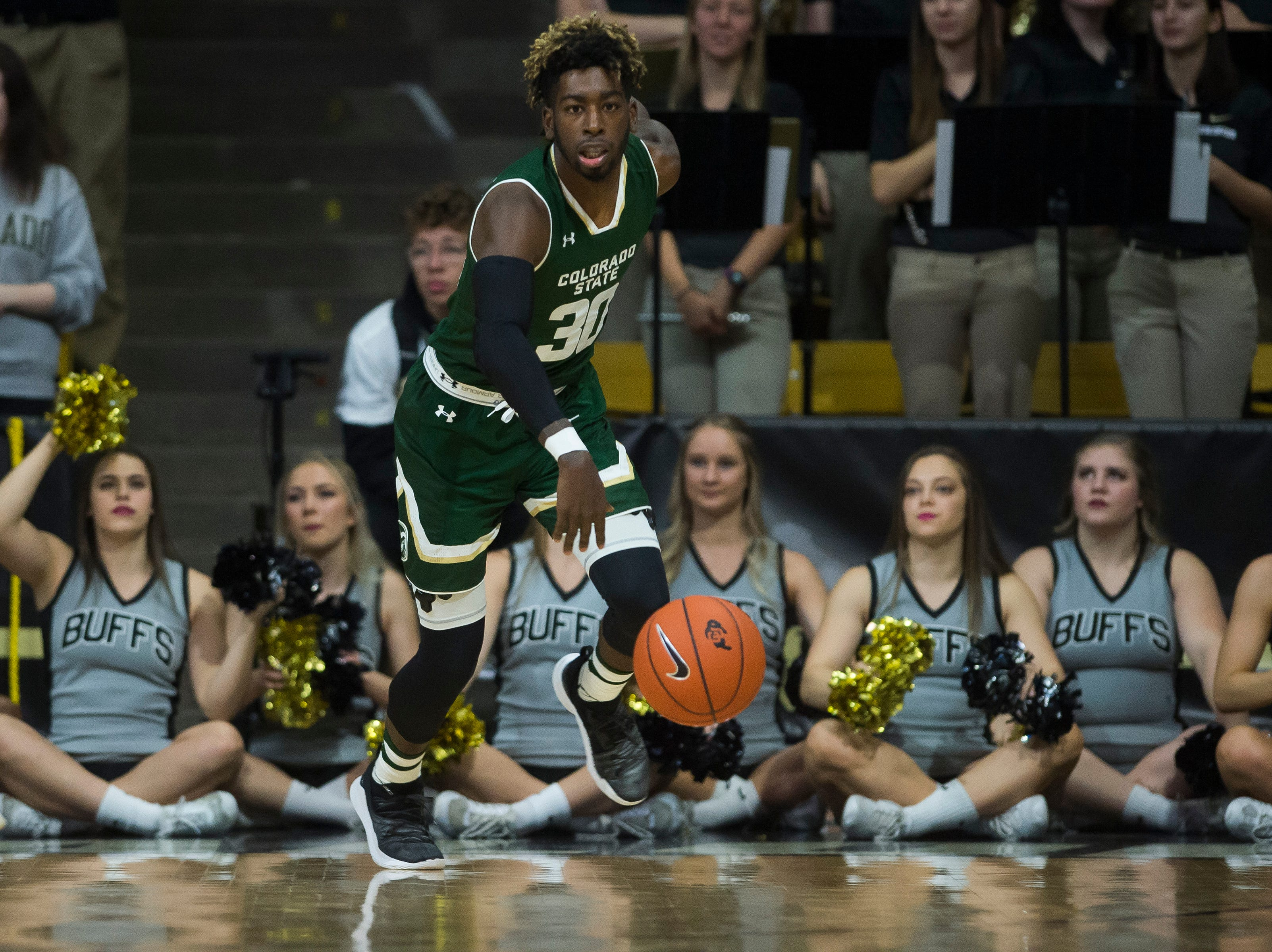 Colorado State University junior guard Kris Martin (30) takes the ball down-court during a game against the University of Colorado on Saturday, Dec. 1, 2018, at the CU Event Center in Boulder, Colo.