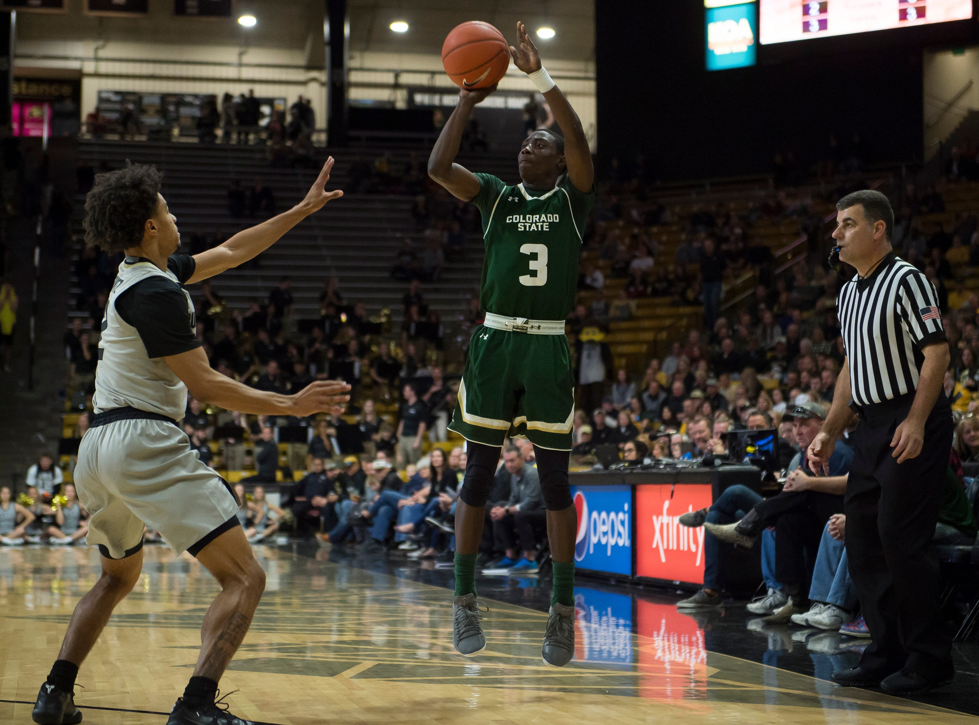 Colorado State University freshman guard Kendle Moore (3) puts up a shot during a game against the University of Colorado on Saturday, Dec. 1, 2018, at the CU Event Center in Boulder, Colo.
