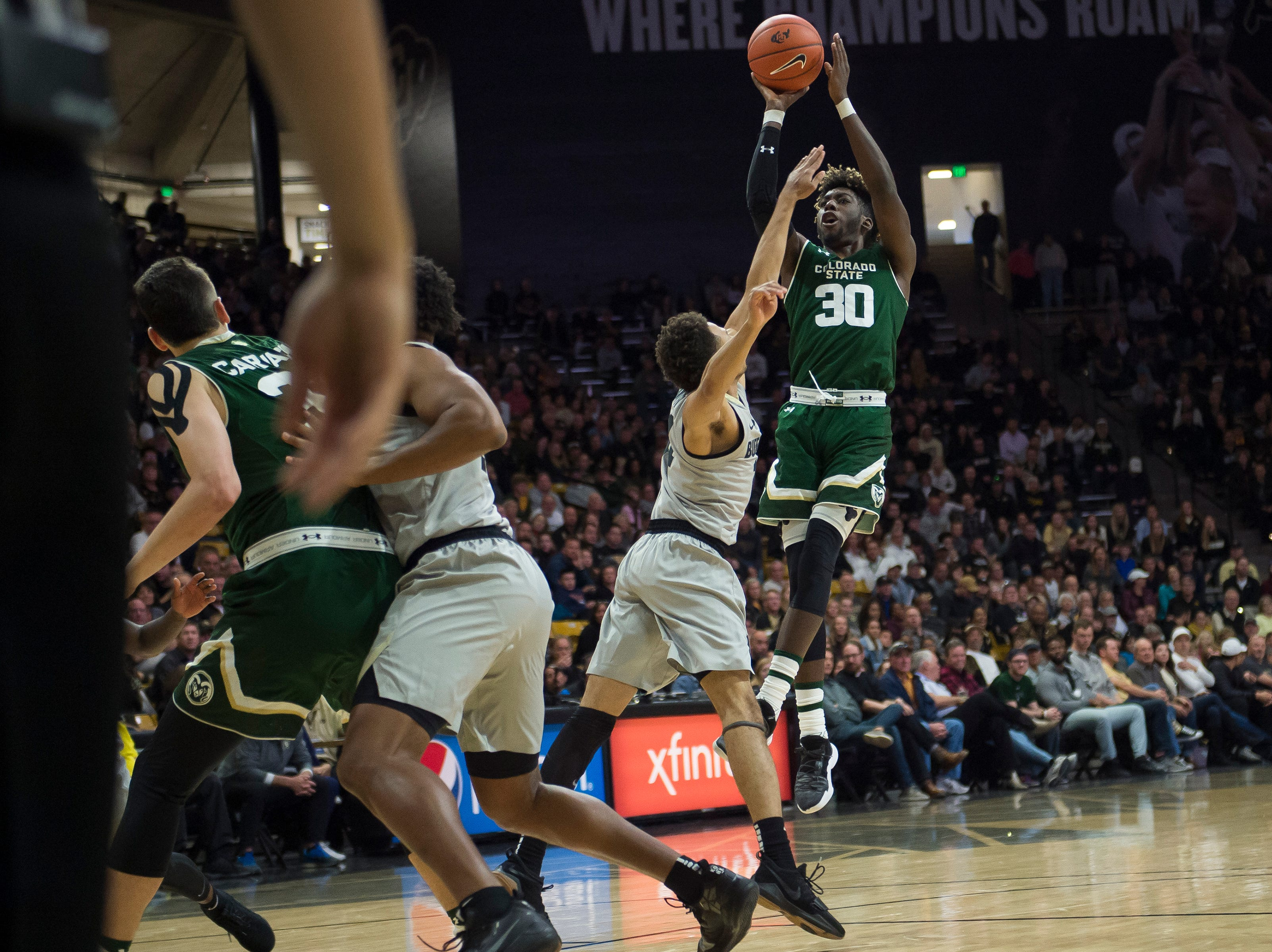 Colorado State University junior guard Kris Martin (30) takes a fading shot during a game against the University of Colorado on Saturday, Dec. 1, 2018, at the CU Event Center in Boulder, Colo.