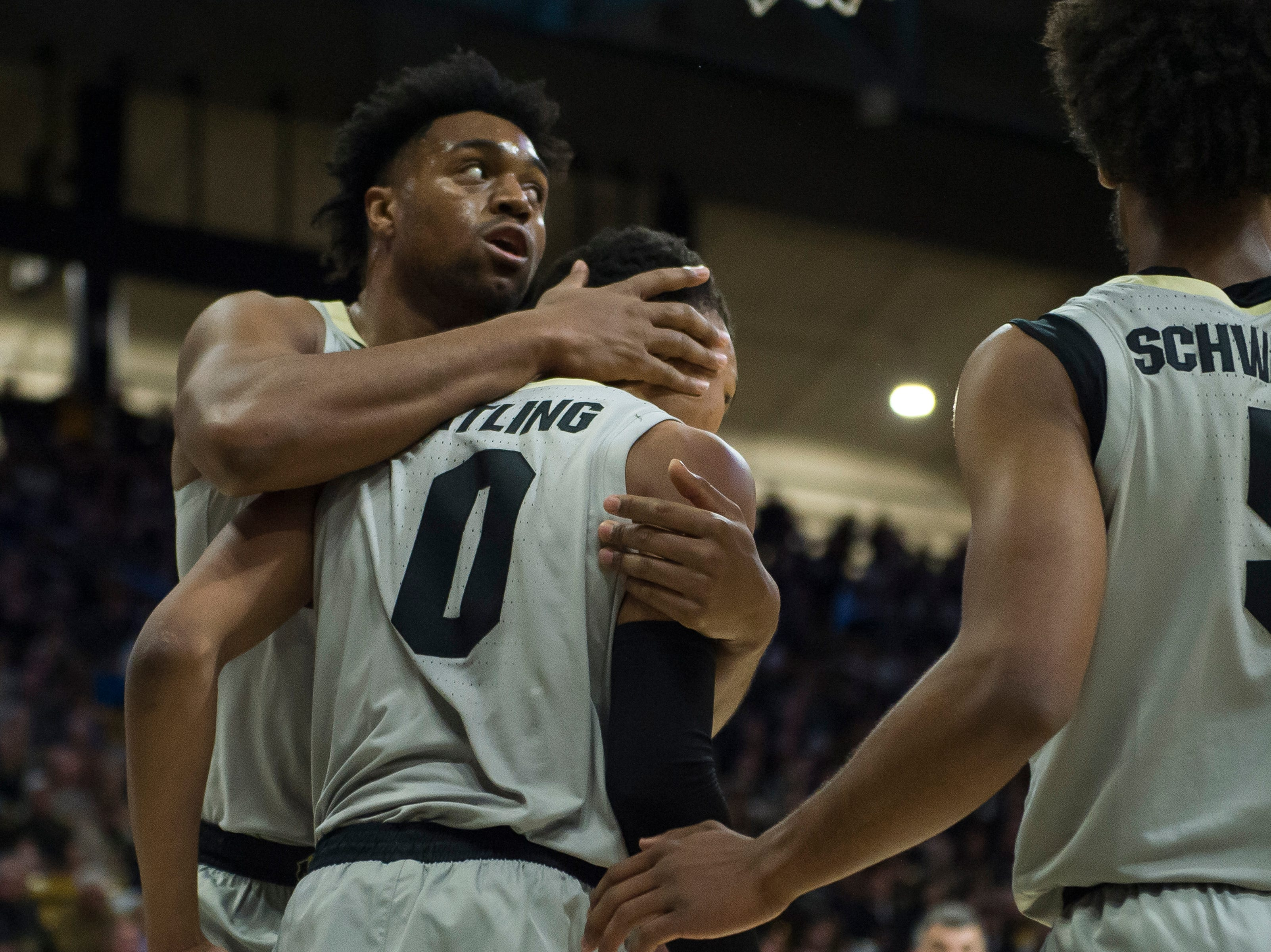 University of Colorado freshman forward Evan Battey (21) comforts junior guard Shane Gatling (0) during game against Colorado State University on Saturday, Dec. 1, 2018, at the CU Event Center in Boulder, Colo.