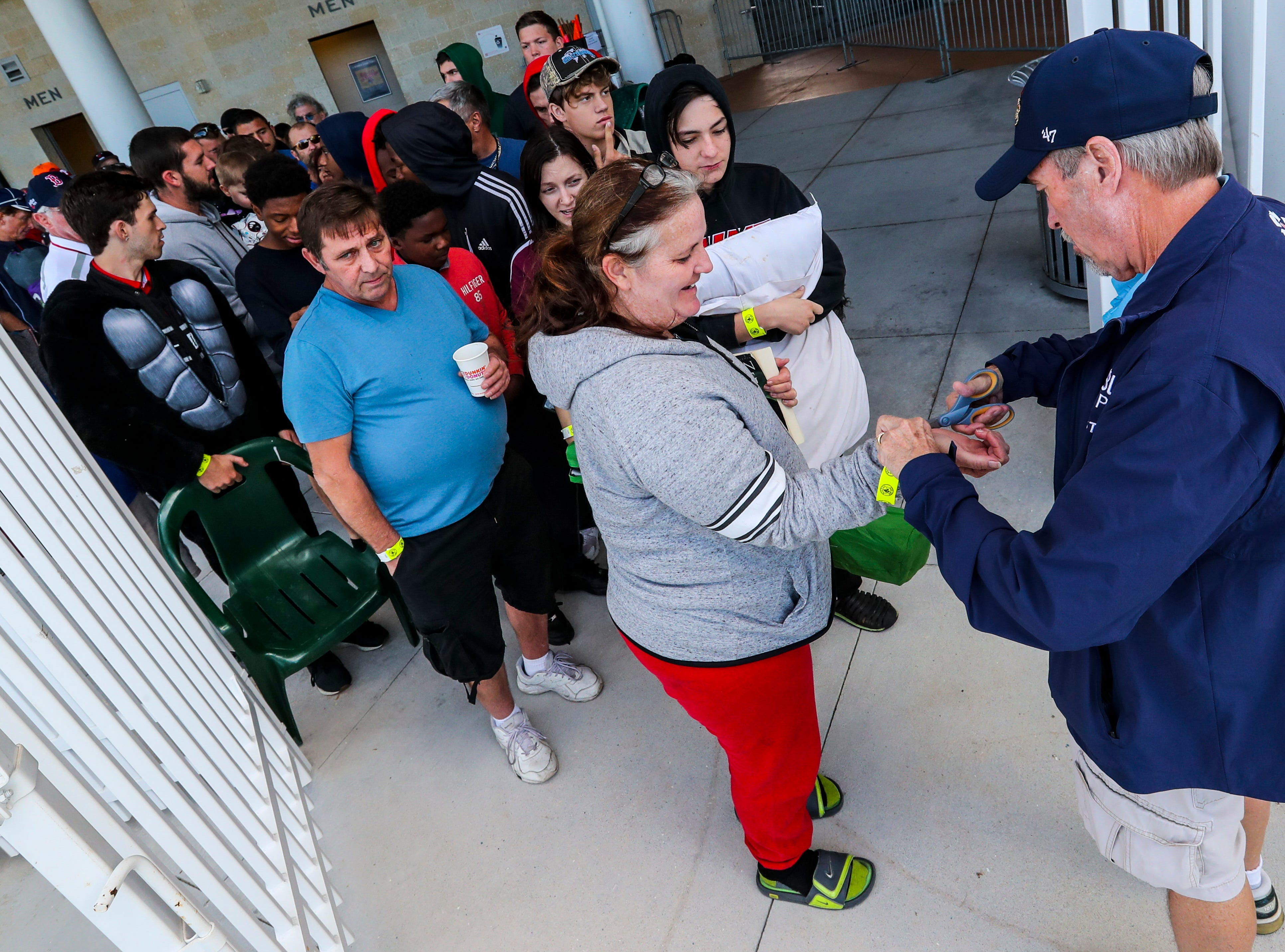 Boston fans gathered in line for spring training tickets. The crowd is excited for this season after the Red Sox won the World Series.