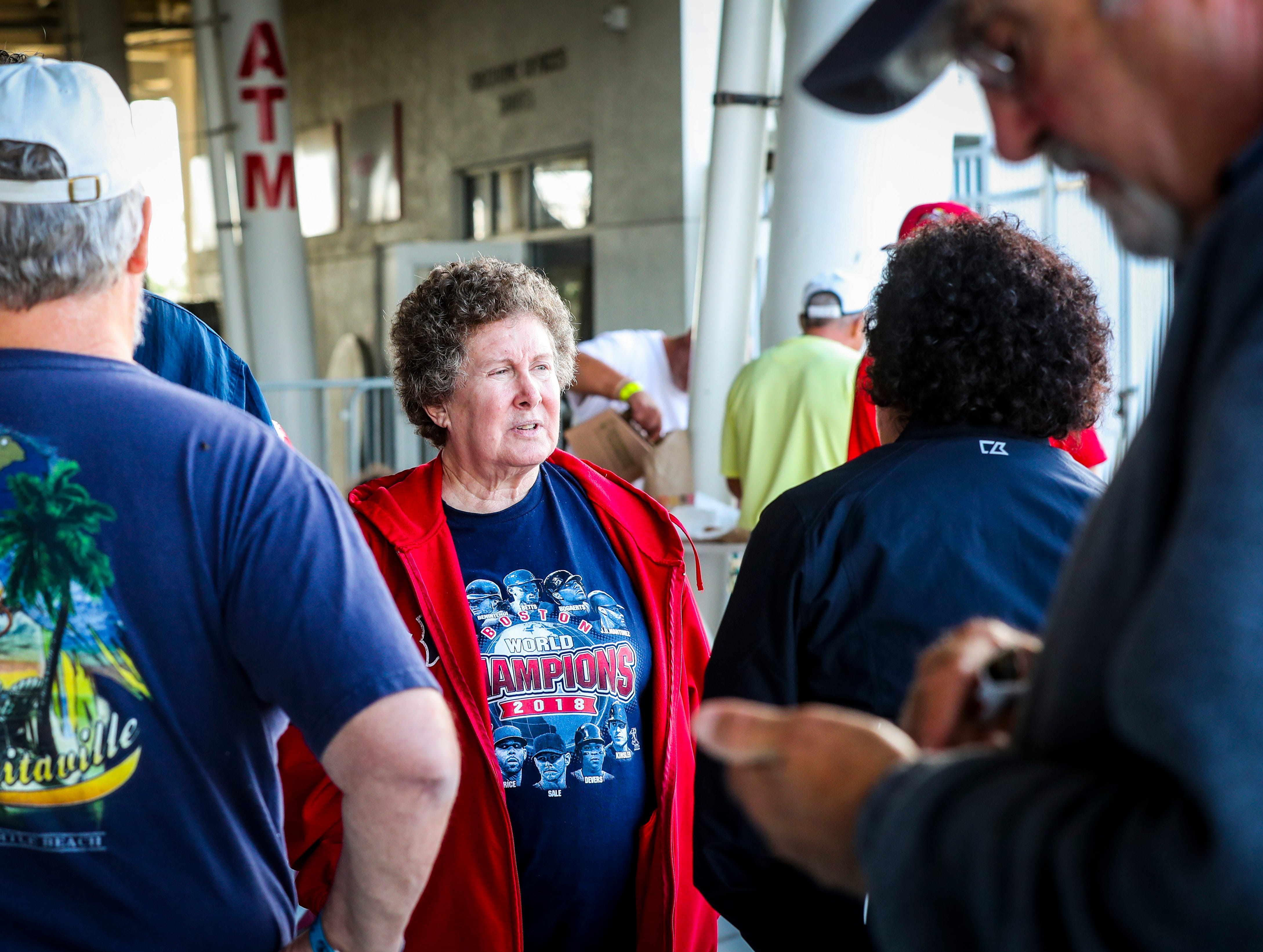 Ann Kristal made her second straight solo trip from Jacksonville. She visits with fellow fans. Boston fans gathered in line for spring training tickets. The crowd is excited for this season after the Red Sox won the World Series.