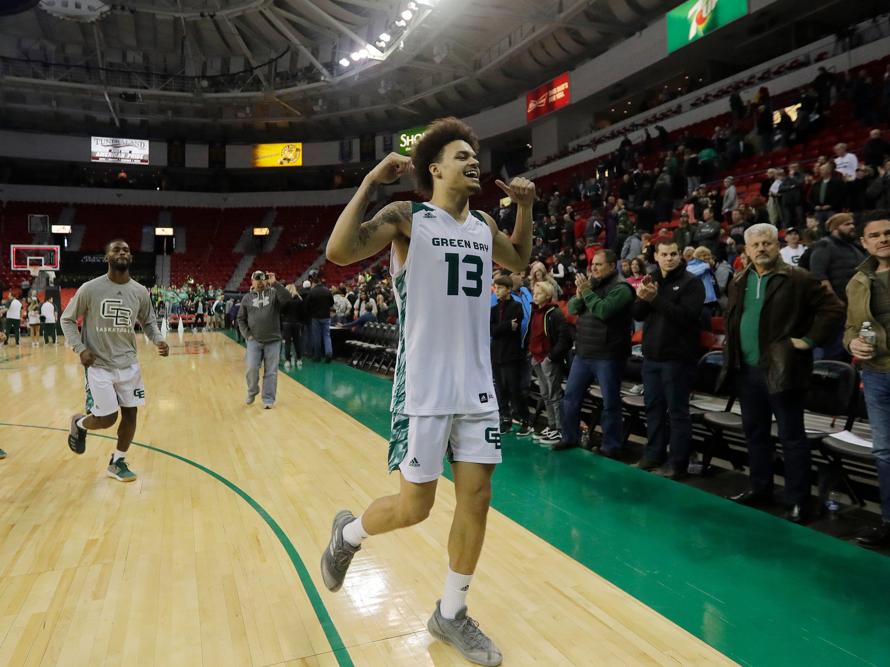 Green Bay Phoenix guard Trevian Bell (13) celebrates as he leaves the court of the the Phoenix defeated the Belmont Bruins in a NCAA basketball game at the Resch Center on Saturday, December 1, 2018 in Ashwaubenon, Wis.