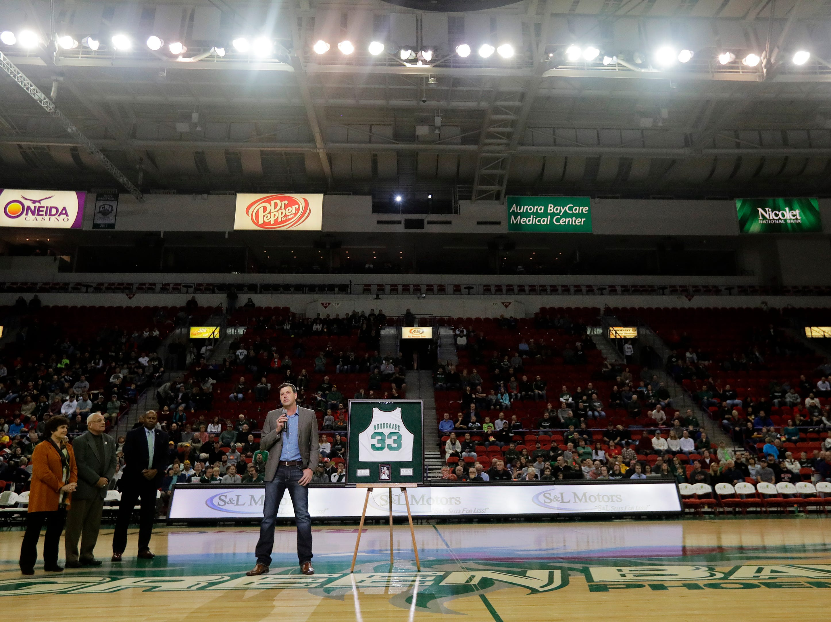 Former UW-Green Bay basketball player Jeff Nordgaard speaks to the crowd after his jersey was retired during halftime of a NCAA basketball game at the Resch Center on Saturday, December 1, 2018 in Ashwaubenon, Wis.