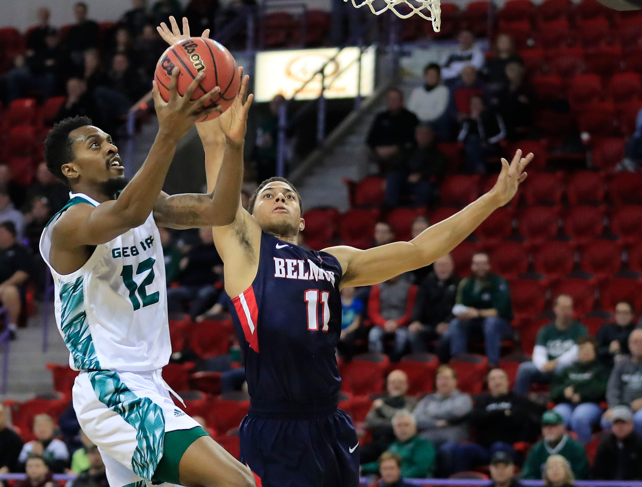 Green Bay Phoenix forward Josh McNair (12) drives to the basket against Belmont Bruins guard Kevin McClain (11) in a NCAA basketball game at the Resch Center on Saturday, December 1, 2018 in Ashwaubenon, Wis.