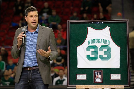 Former UW-Green Bay basketball player Jeff Nordgaard speaks to the crowd after his jersey was retired during halftime of the Phoenix's game at the Resch Center on Saturday.