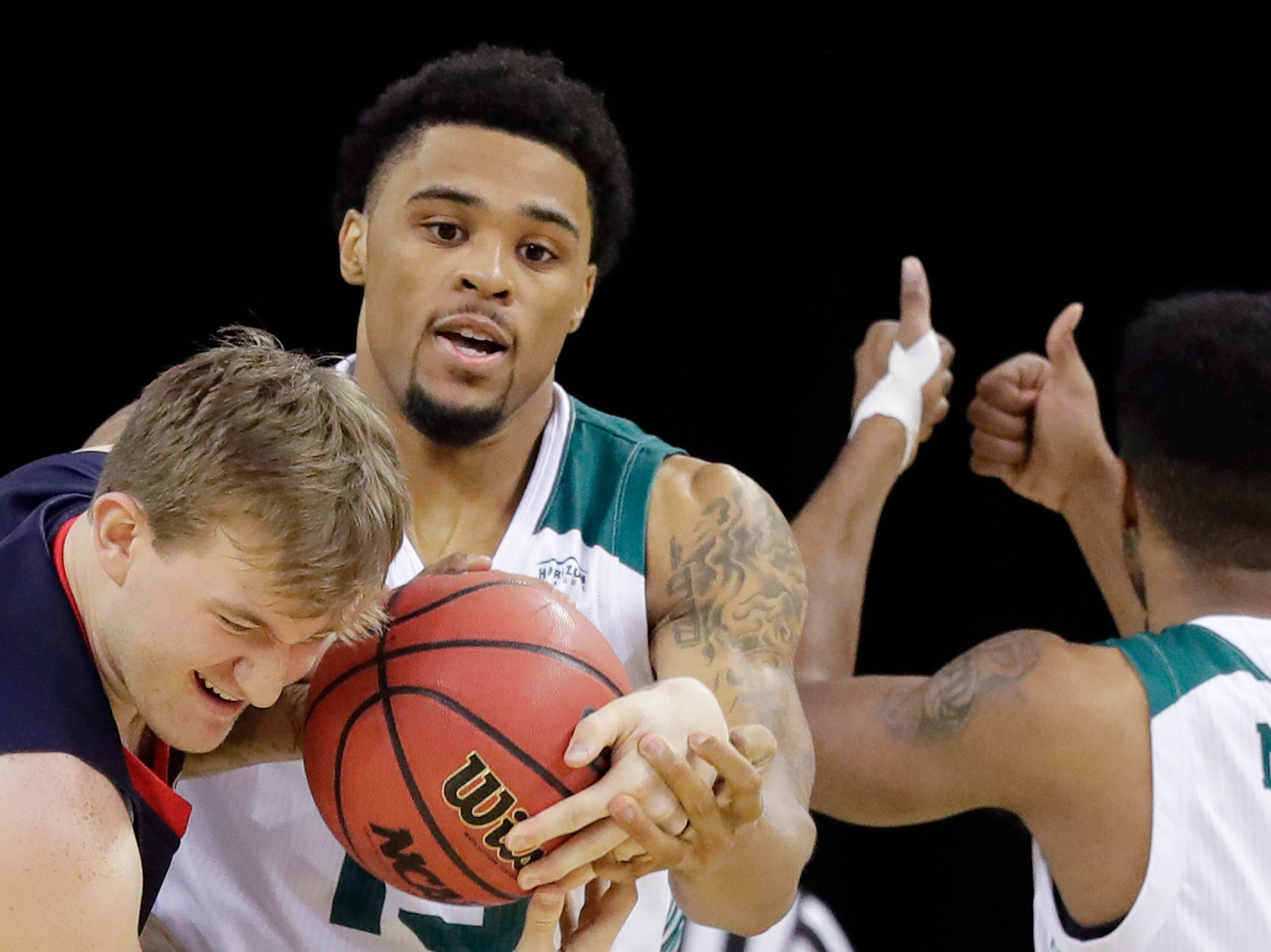 Green Bay Phoenix forward Manny Patterson (15) and Belmont Bruins forward Caleb Hollander (10) get tied up in a NCAA basketball game at the Resch Center on Saturday, December 1, 2018 in Ashwaubenon, Wis.