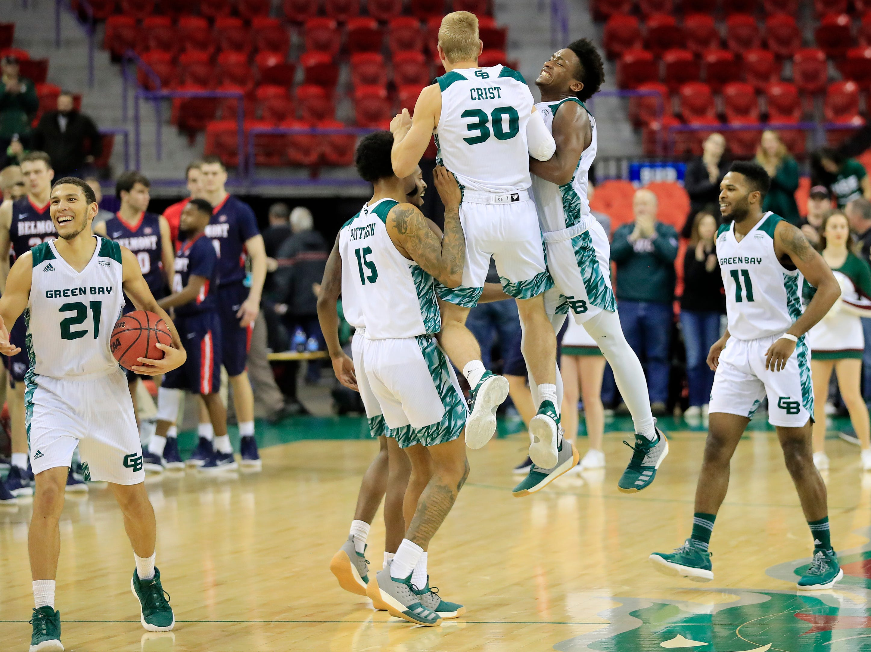 Green Bay Phoenix players celebrate after defeating the Belmont Bruins in a NCAA basketball game at the Resch Center on Saturday, December 1, 2018 in Ashwaubenon, Wis.