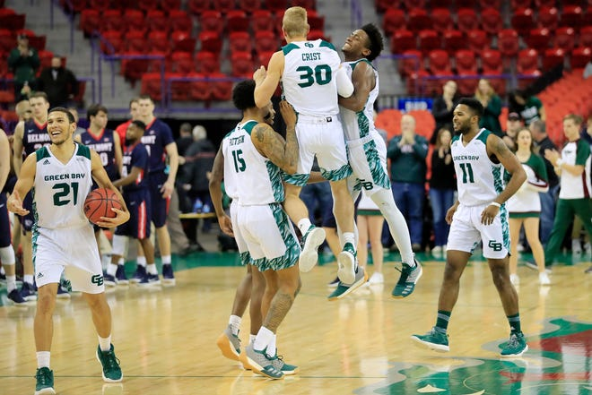 UWGB celebrates after beating Belmont on Saturday, handing the Bruins their first loss of the season.