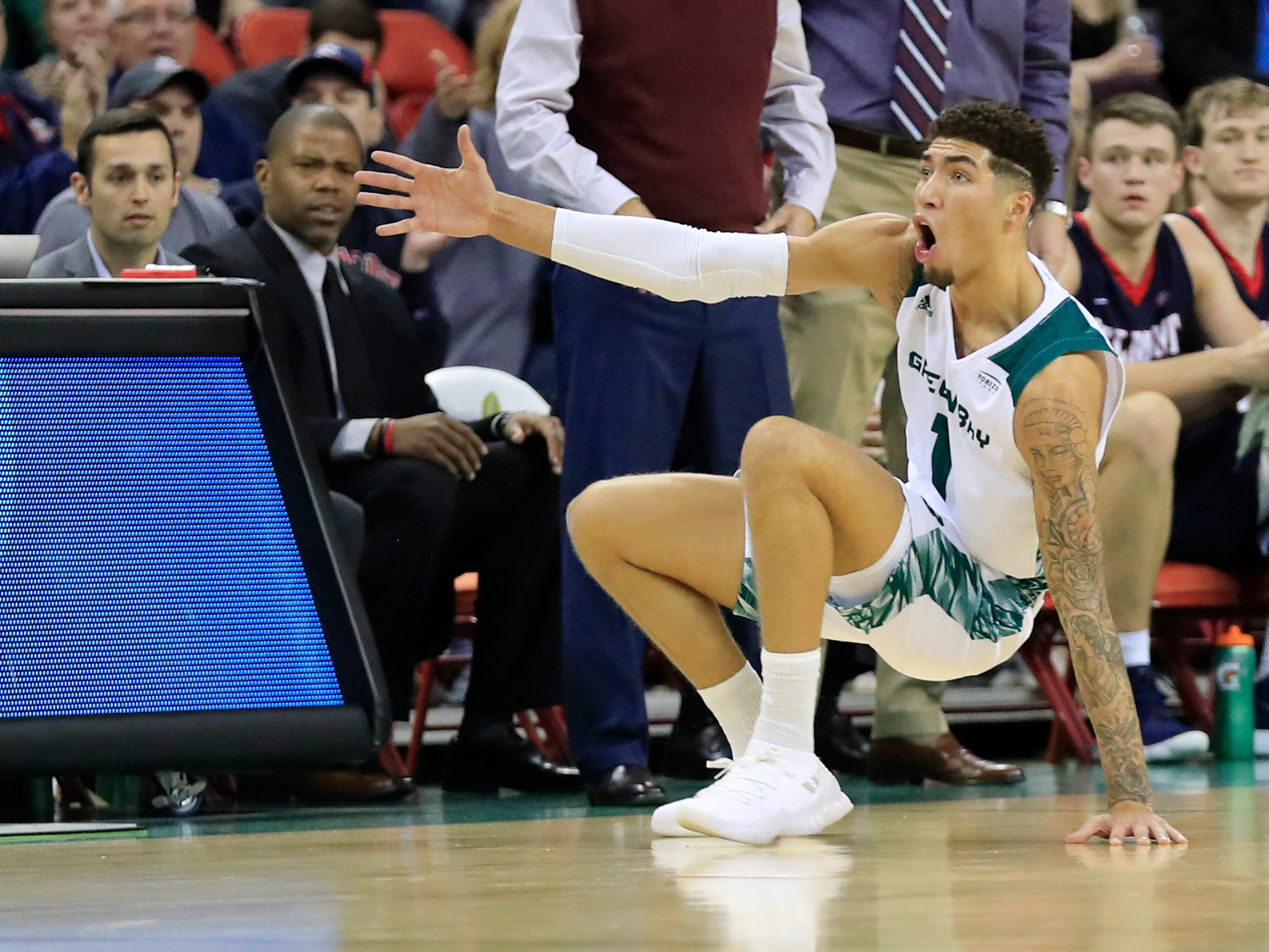 Green Bay Phoenix guard Sandy Cohen III (1) reacts after being called for a foul in a NCAA basketball game against the Belmont Bruins at the Resch Center on Saturday, December 1, 2018 in Ashwaubenon, Wis.