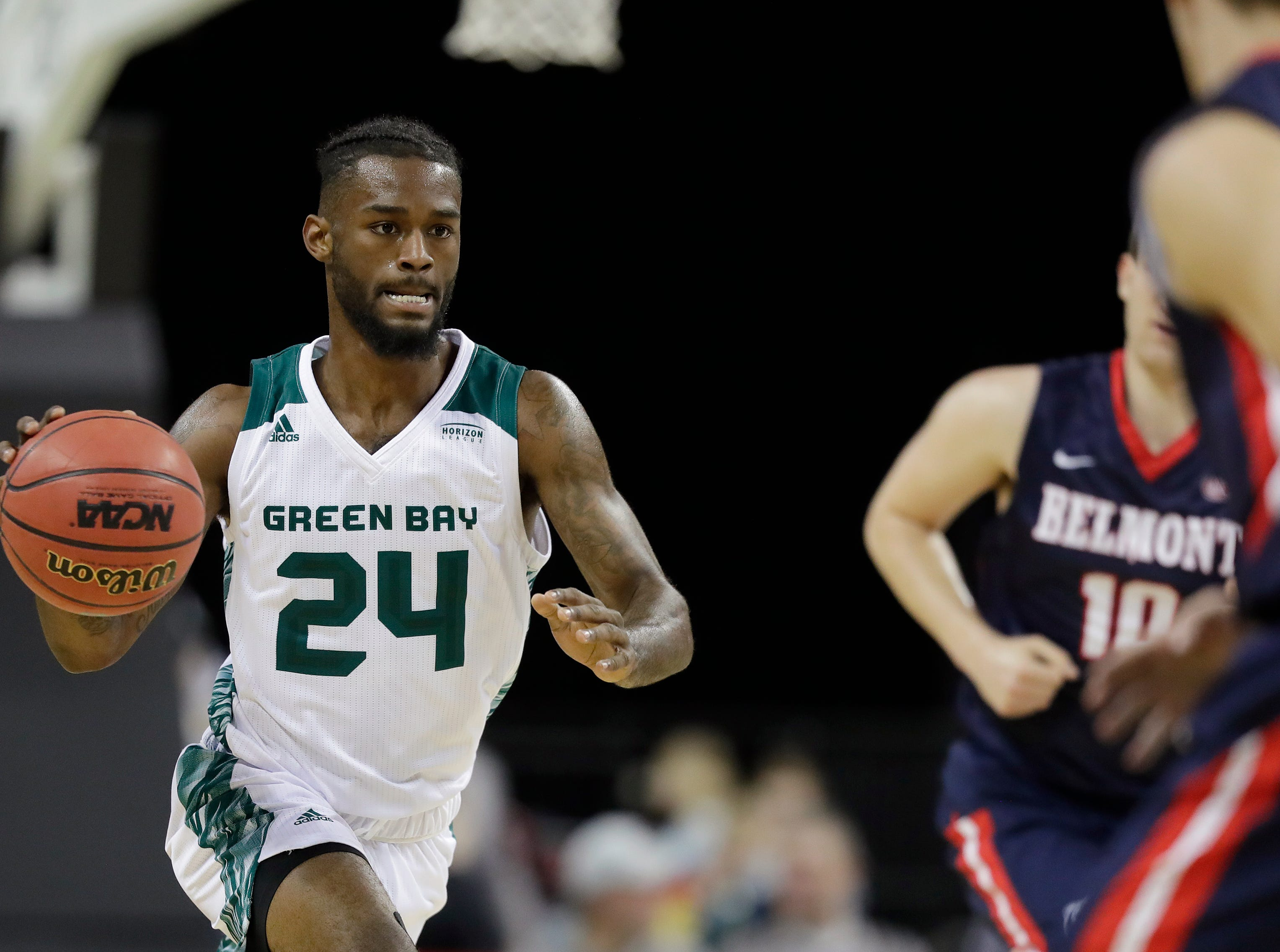 Green Bay Phoenix guard Jevon Smith (24) dribbles against the Belmont Bruins in a NCAA basketball game at the Resch Center on Saturday, December 1, 2018 in Ashwaubenon, Wis.