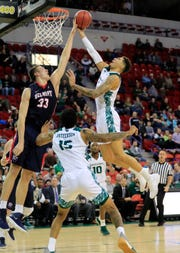 UWGB guard Sandy Cohen III (1) is averaging 14.1 points and 6.6 rebounds this season.