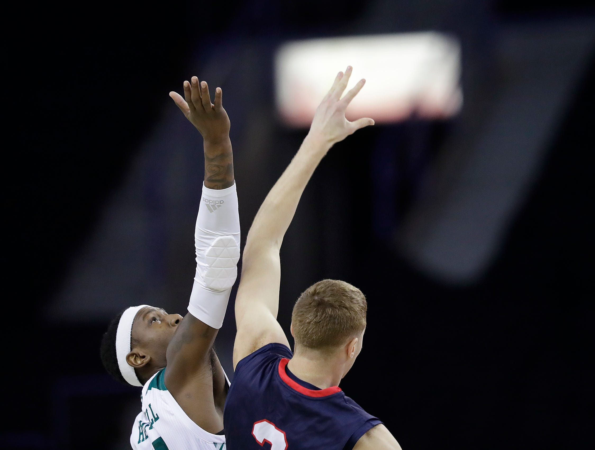 Green Bay Phoenix forward Shanquan Hemphill (10) contests the opening tipoff against Belmont Bruins guard Dylan Windler (3) in a NCAA basketball game at the Resch Center on Saturday, December 1, 2018 in Ashwaubenon, Wis.