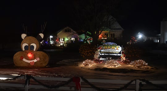 A snowman and Rudolph created with round hay bales helped Ebert Enterprises in Algoma win a first place in last year's Great Kewaunee County Holiday Light Contest.