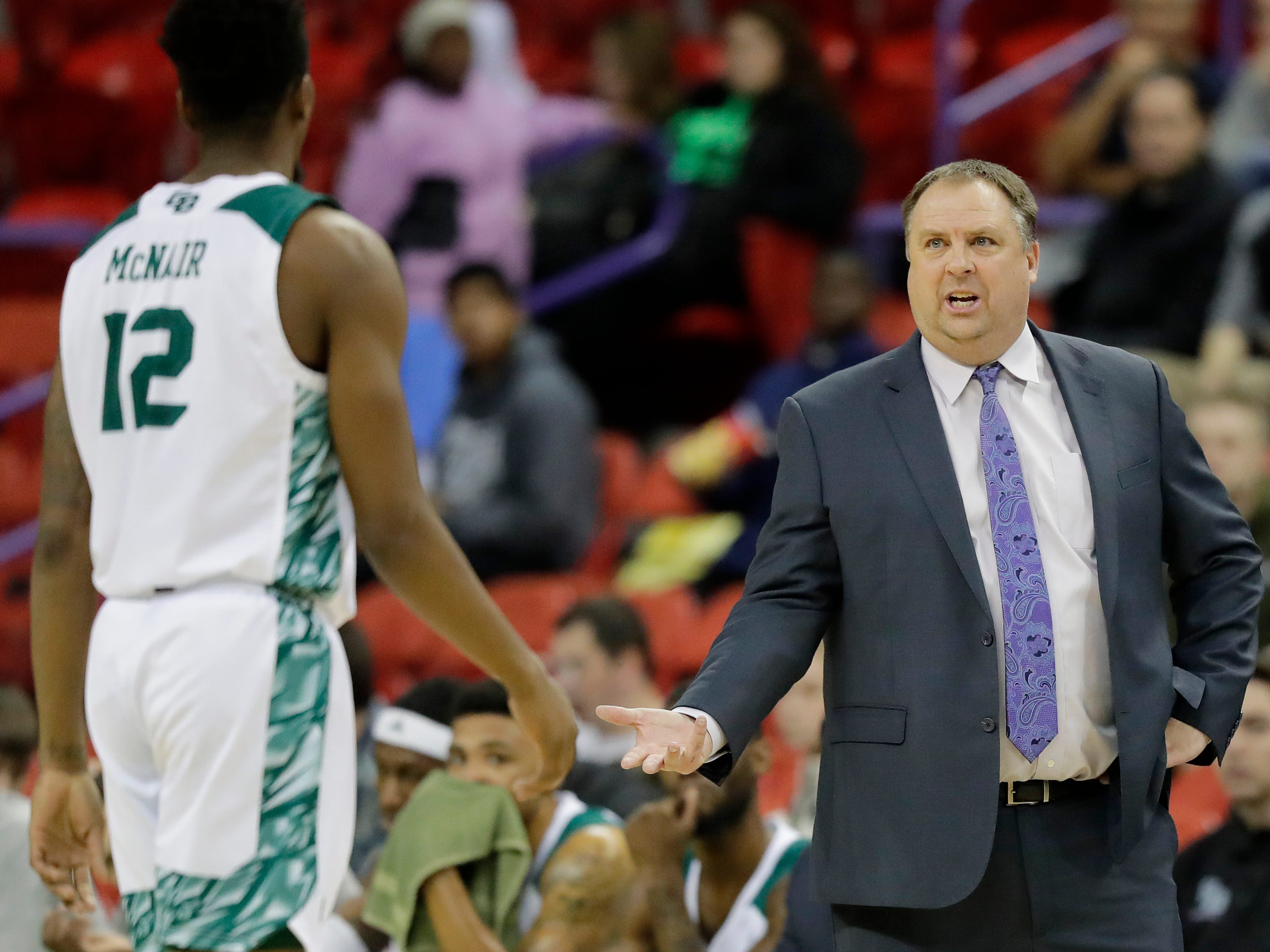 Green Bay Phoenix head coach Linc Darner talks to forward Josh McNair (12) in a NCAA basketball game at the Resch Center on Saturday, December 1, 2018 in Ashwaubenon, Wis.
