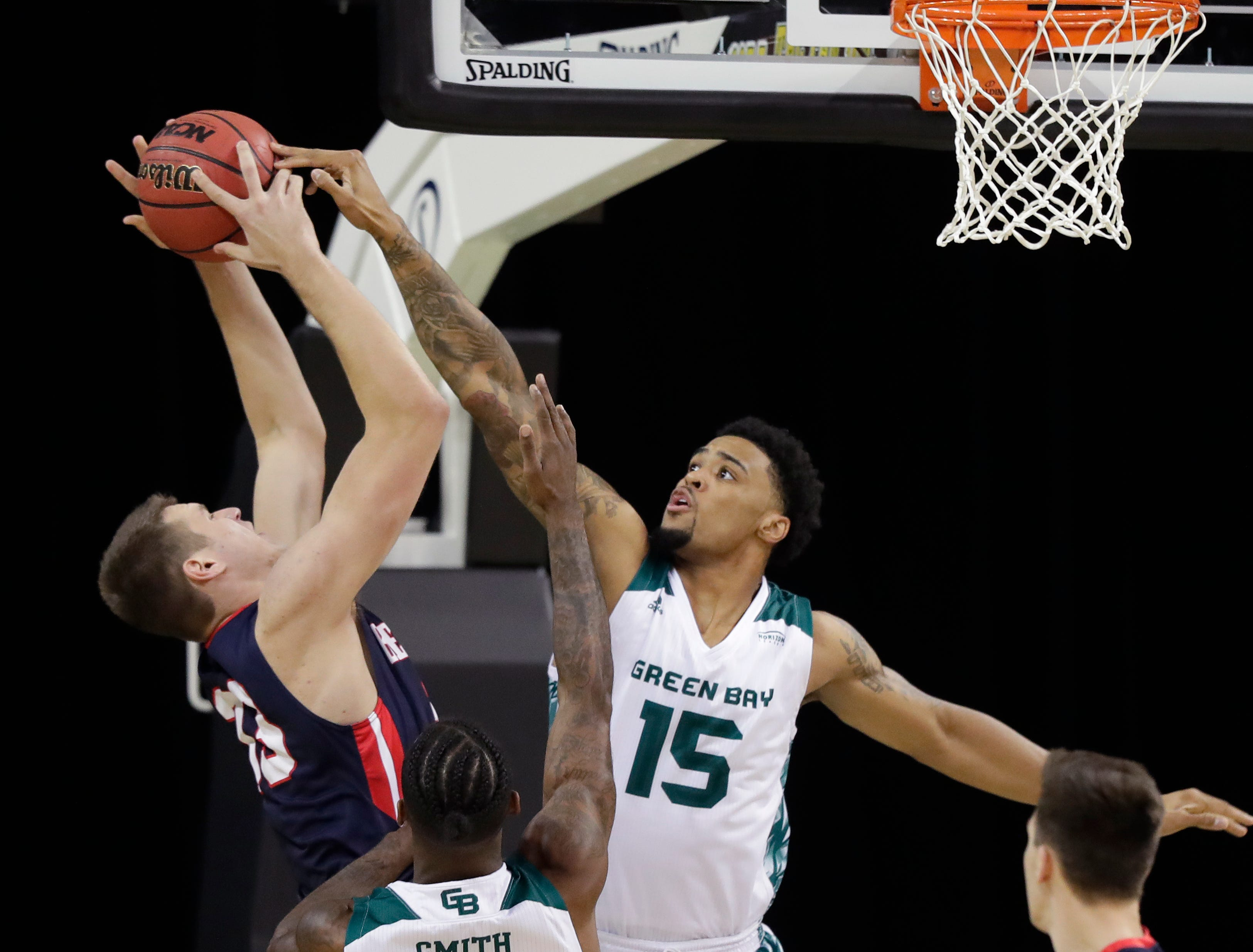 Green Bay Phoenix forward Manny Patterson (15) defends against Belmont Bruins center Nick Muszynski (33) in a NCAA basketball game at the Resch Center on Saturday, December 1, 2018 in Ashwaubenon, Wis.
