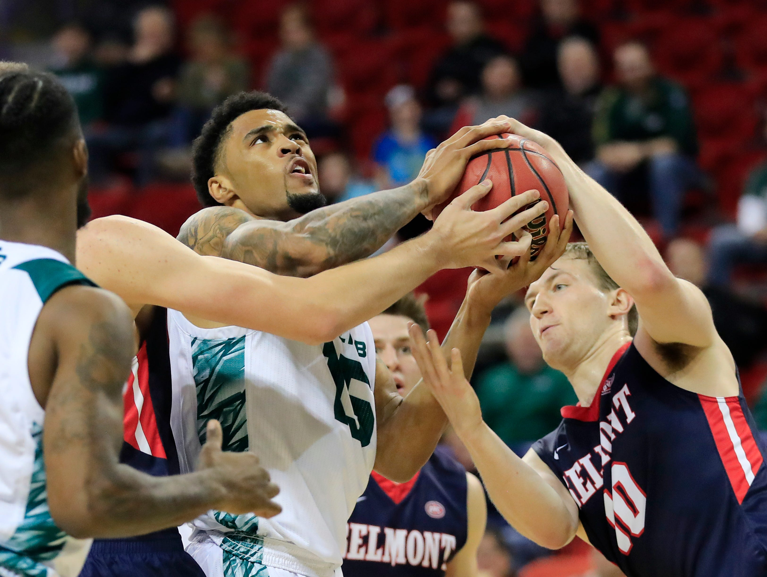 Green Bay Phoenix forward Manny Patterson (15) and Belmont Bruins forward Caleb Hollander (10) compete for a rebound in a NCAA basketball game at the Resch Center on Saturday, December 1, 2018 in Ashwaubenon, Wis.
