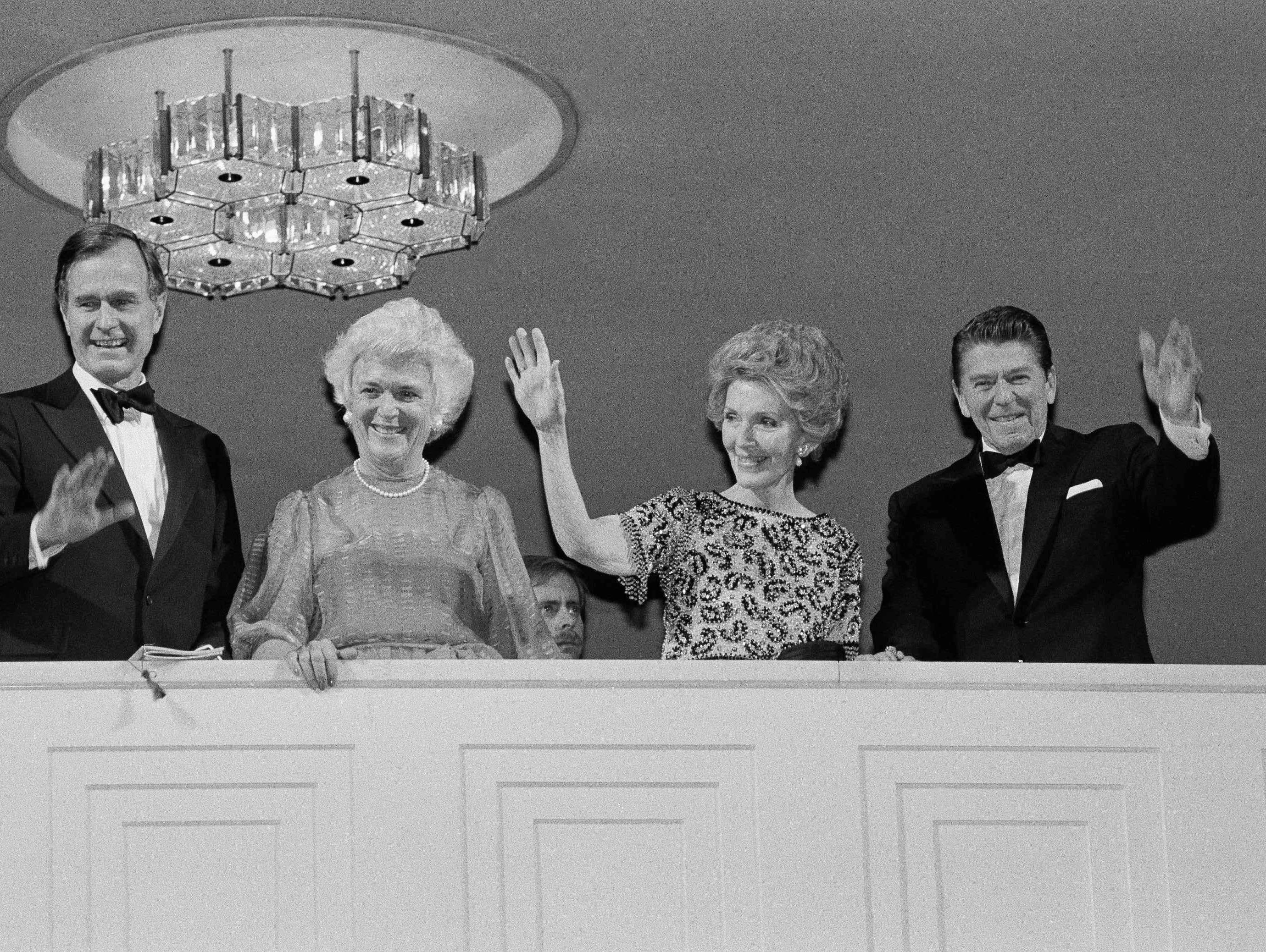 President-elect Ronald Reagan and his wife Nancy wave from the balcony at the Kennedy Center in Washington on Sunday, Jan. 18, 1981, where they attended a concert. With the Reagans are Vice President-elect George H.W. Bush, left, and his wife Barbara. (AP Photo)