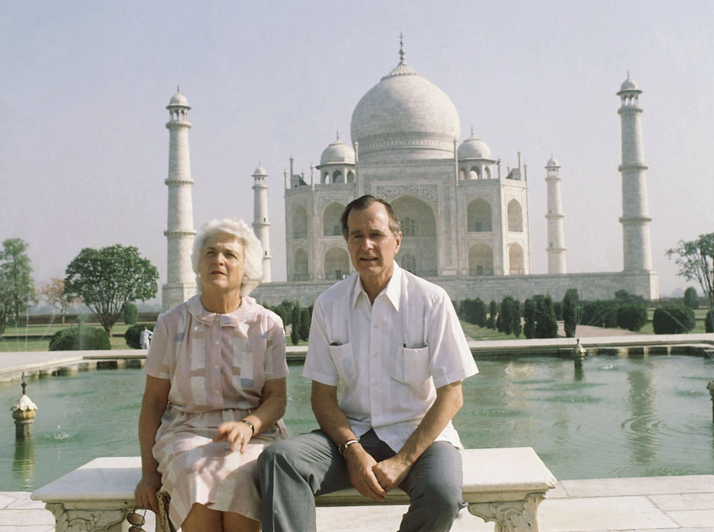 U.S. Vice President George H. W. Bush, right, and his wife Barbara Bush pose in front of the Taj Mahal, the 17th century monument to love was built by a Mughal Emperor Sahajahan in memory of his beloved queen who bore 14 children, Saturday, May 13, 1984, Agra, India. (AP Photo/Sondeep Shankar)