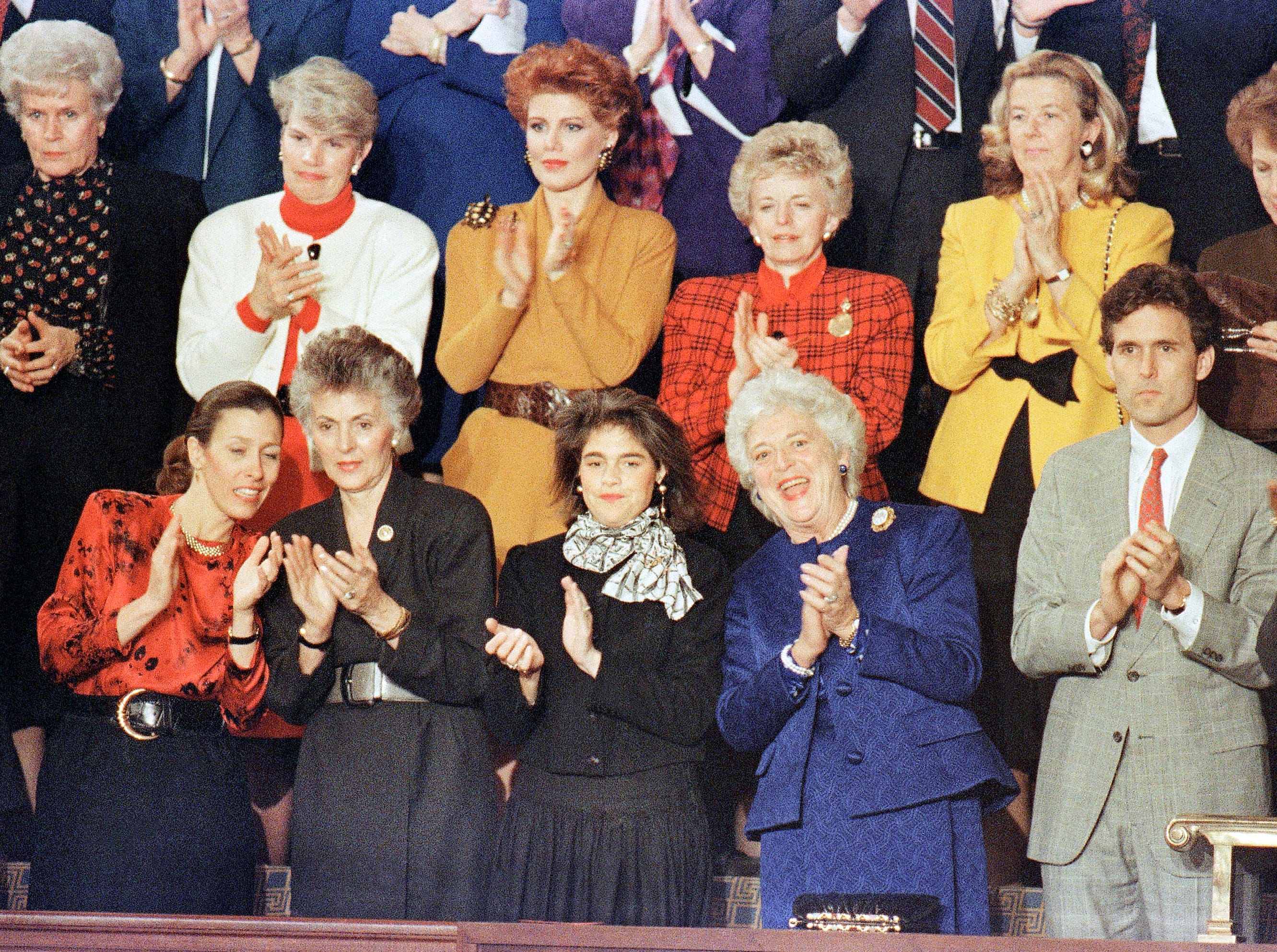 Mrs. Barbara Bush, center, is joined by Margaret and Marvin Bush as they applaud President George H.W. Bush's arrival to the House chamber in Washington on Jan. 31, 1990 where the president made his first State of the Union address. (AP Photo/Doug Mills)
