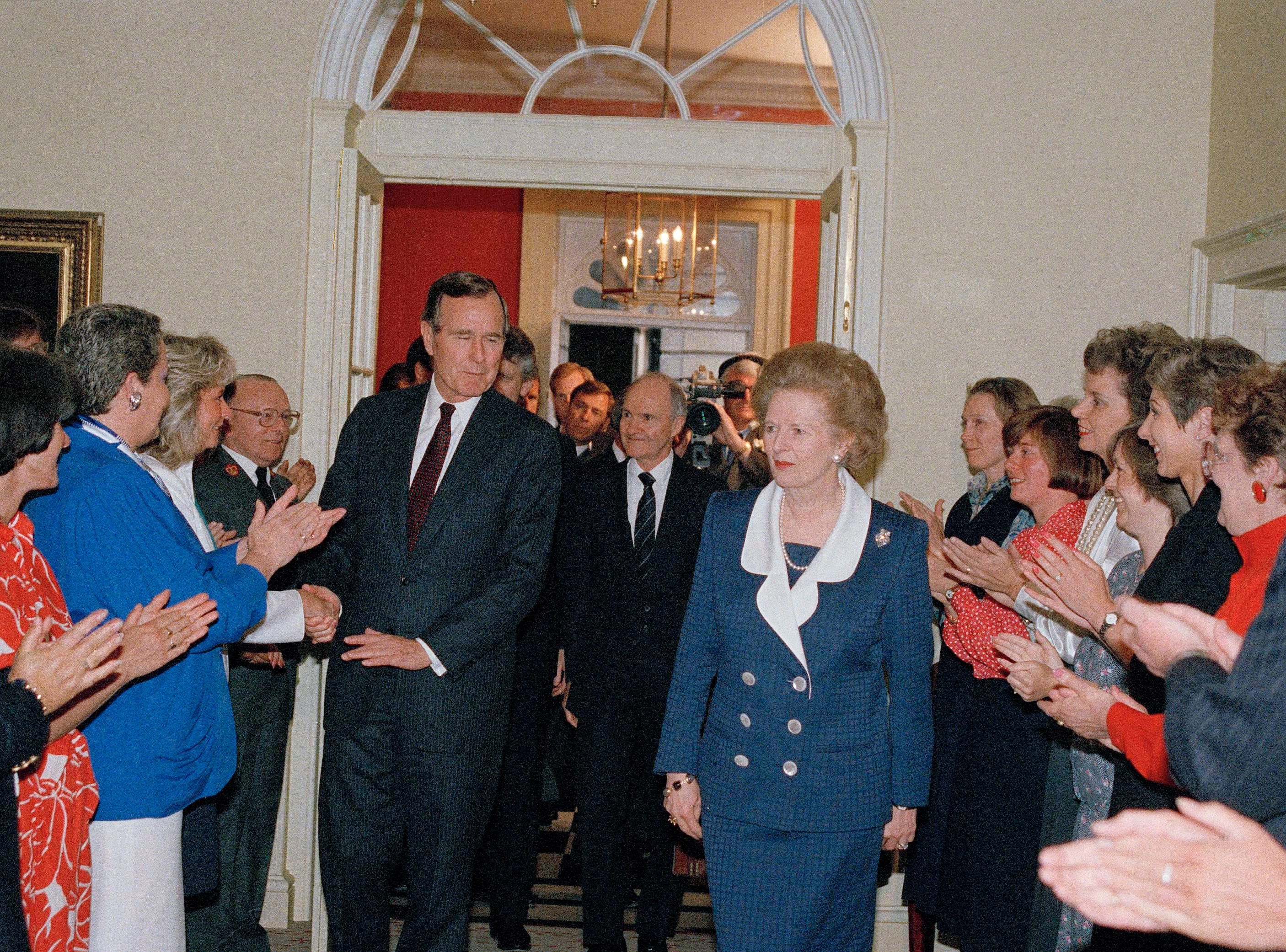 The staff of 10 Downing Street applaud President George Bush and Prime Minister Margaret Thatcher at 10 Downing Street in London, June 1, 1989.  (AP Photo/Dennis Cook)