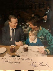 This photograph of then Vice President George H.W. Bush shows him shaking hands with Dan Heidlberg at Buck's Drive In in Easley on Feb. 25, 1988, in this copy of a White House photo that was sent to the Heidlbergs after their son talked to the president.