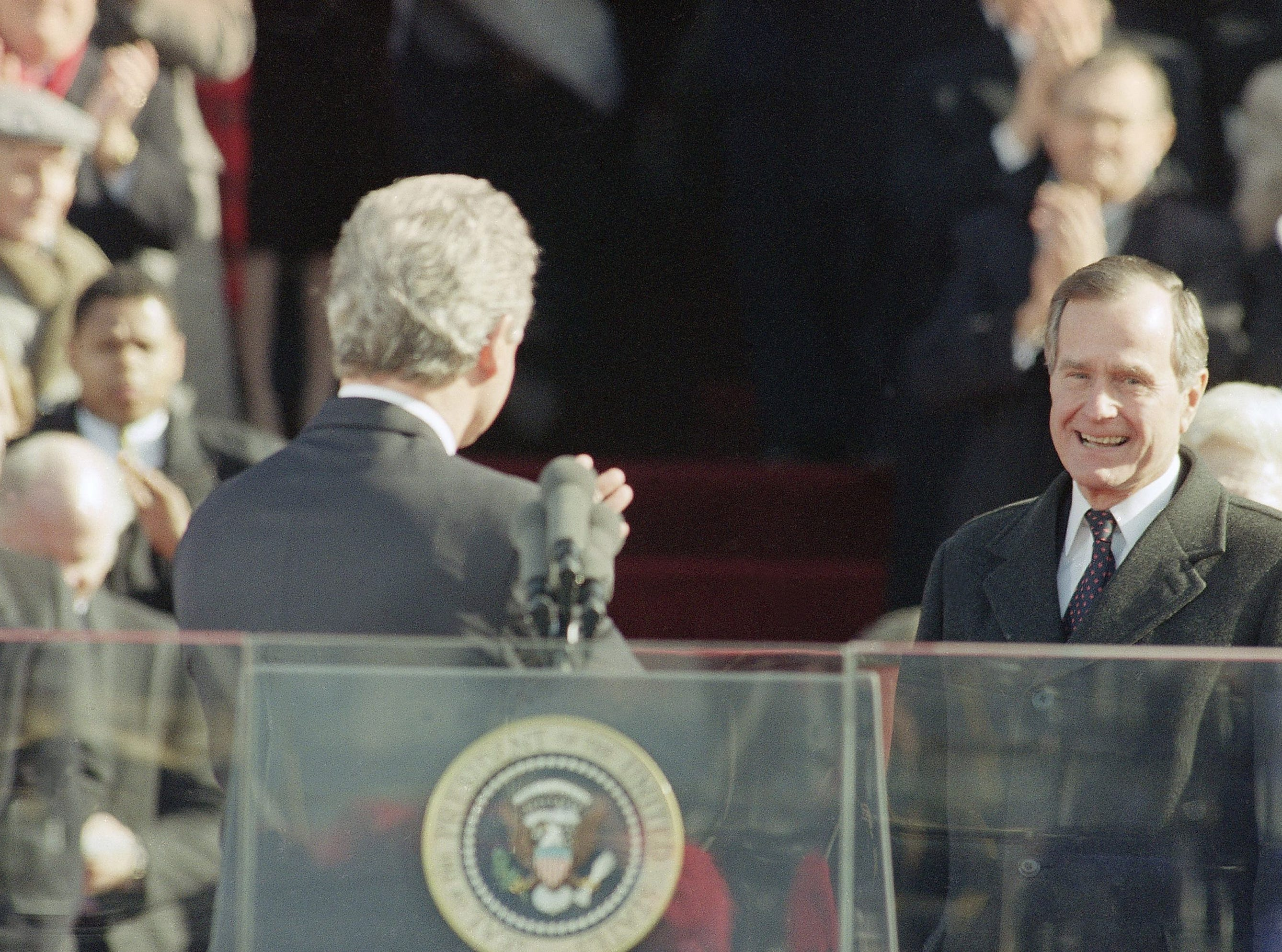 Pres. Bill Clinton, left, gestures toward former Pres. George H. W. Bush after giving his inaugural speech on Capitol Hill, Wednesday, Jan. 21, 1993, Washington, Washington, D.C. (AP Photo/Ron Edmonds)