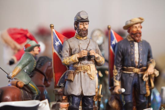 """Frank and Billie Earnests' collection includes whiskey decanters featuring Confederate generals Thomas J. """"Stonewall"""" Jackson, center, and J.E.B. Stuart. MUST CREDIT: Photo for The Washington Post by Timothy C. Wright"""