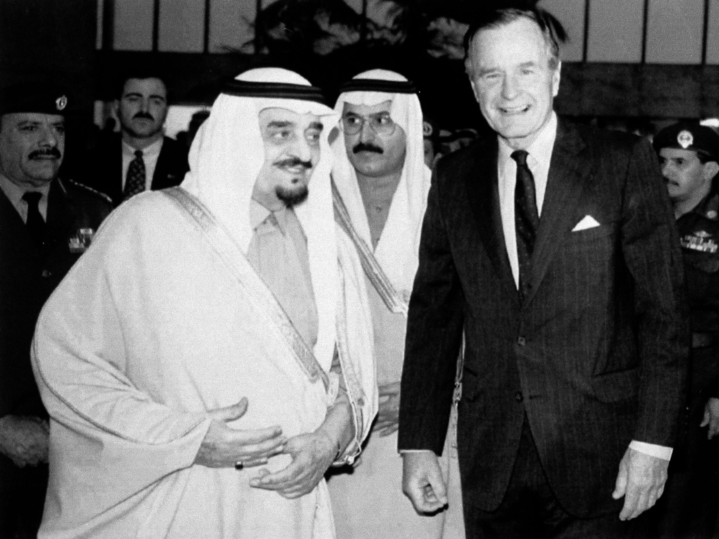 President George Bush, right, meets with King Fahd of Saudi Arabia,left, at the Royal Pavilion of Jeddah, Dec. 31, 1992. Bush was on a short visit to Saudi Arabia and later flew on to Somalia. Man at center is unidentified. (AP Photo/Doug Mills)