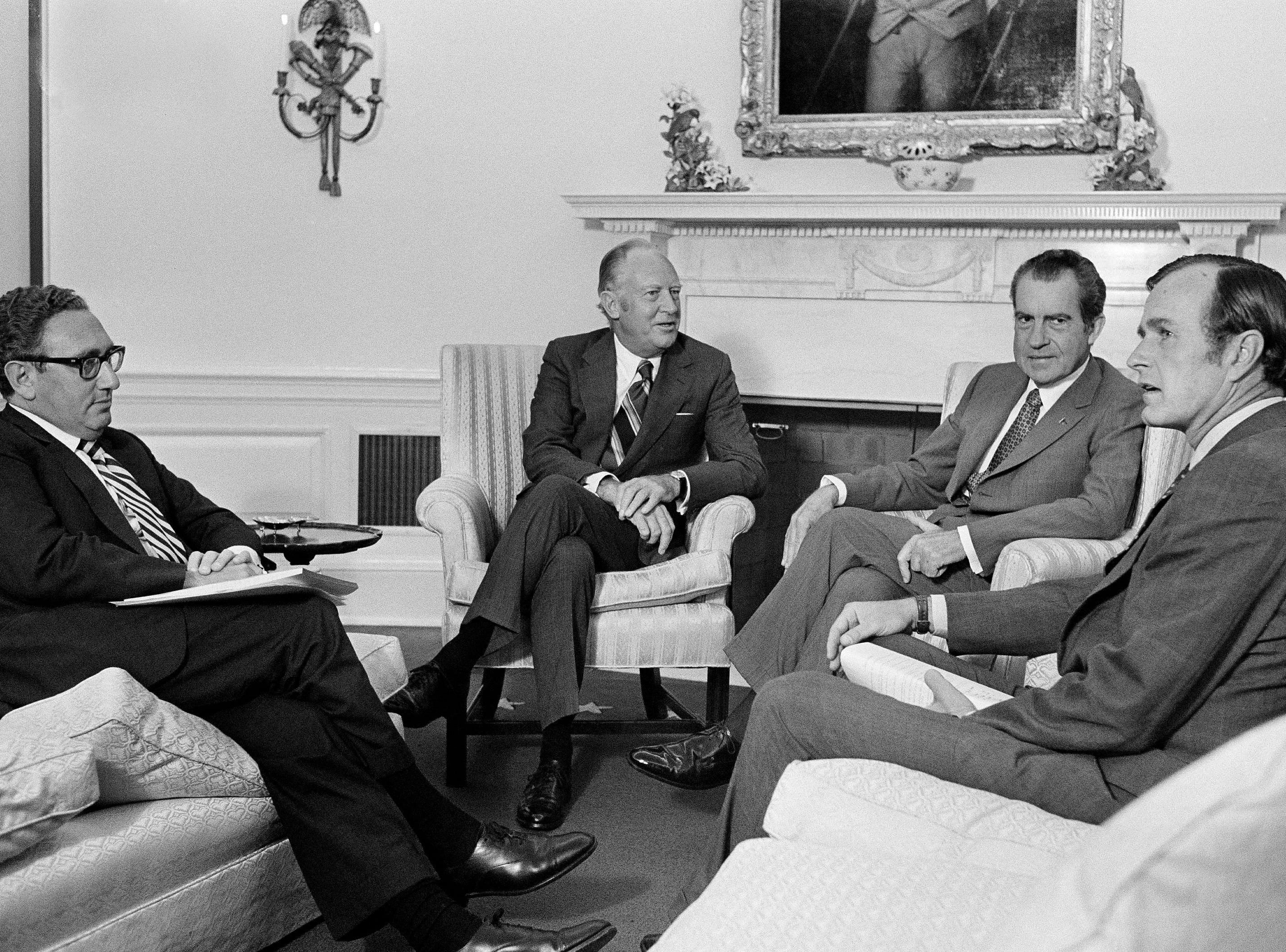 U.S. Ambassador to the United Nations George Bush meets with President Richard Nixon at the White House as the opening neared for the 27th U.N. General Assembly, Sept. 19, 1972. At left are National Security Advisor Henry Kissinger and Secretary of State William P. Rogers. (AP Photo/Jim Palmer)