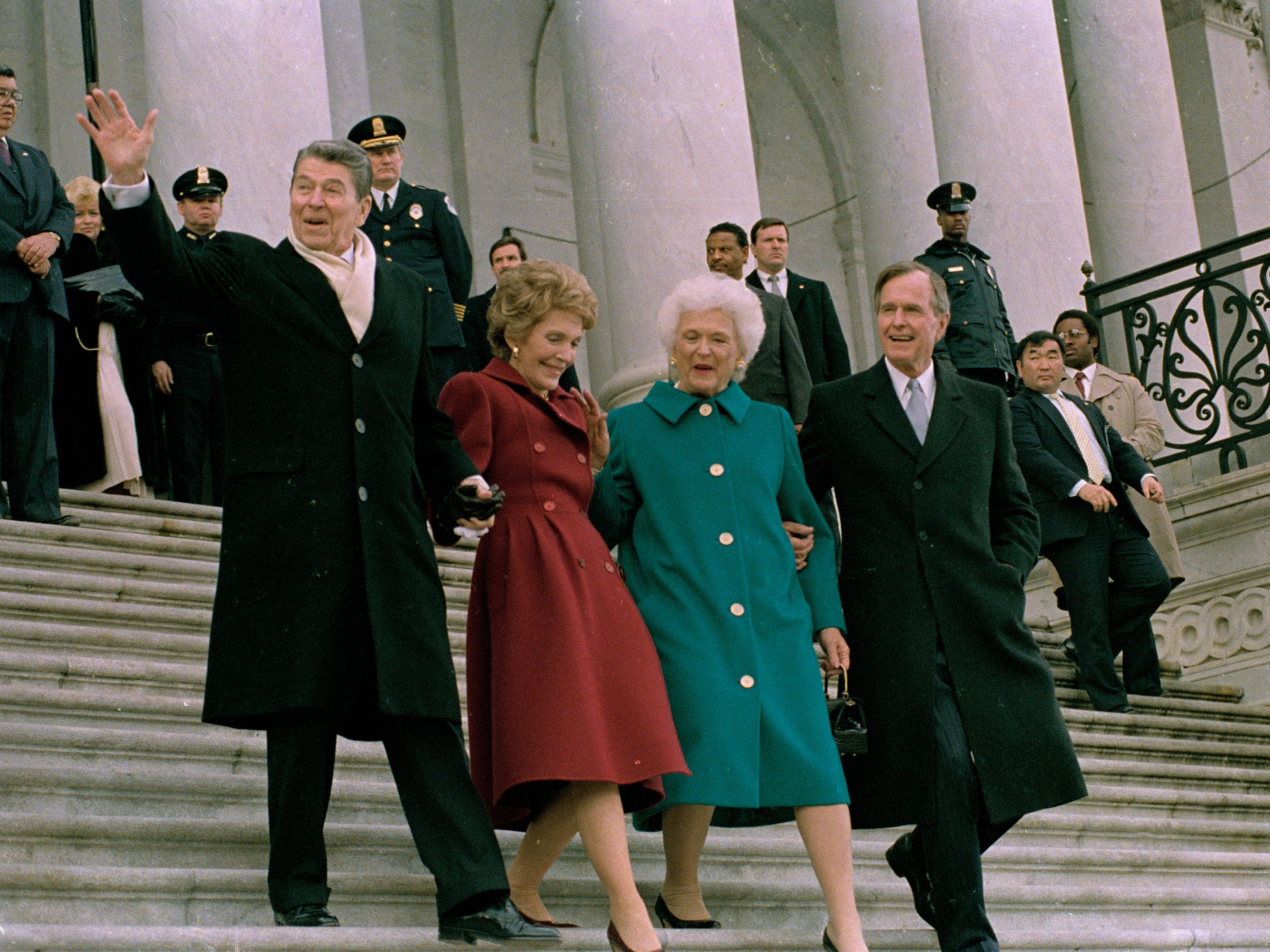 Former President Ronald Reagan, left, his wife Nancy Reagan, new first lady Barbara Bush and her husband President George Bush, right, walk down the Capitol steps after the inaugural ceremony in Washington, D.C., Friday, Jan. 20, 1989.  President Bush was sworn in as the nation's 41st president.  The Reagans are heading to an awaiting helicopter to take them to Andrews Air Force Base, Md., and onto California.  (AP Photo/J. Scott Applewhite)