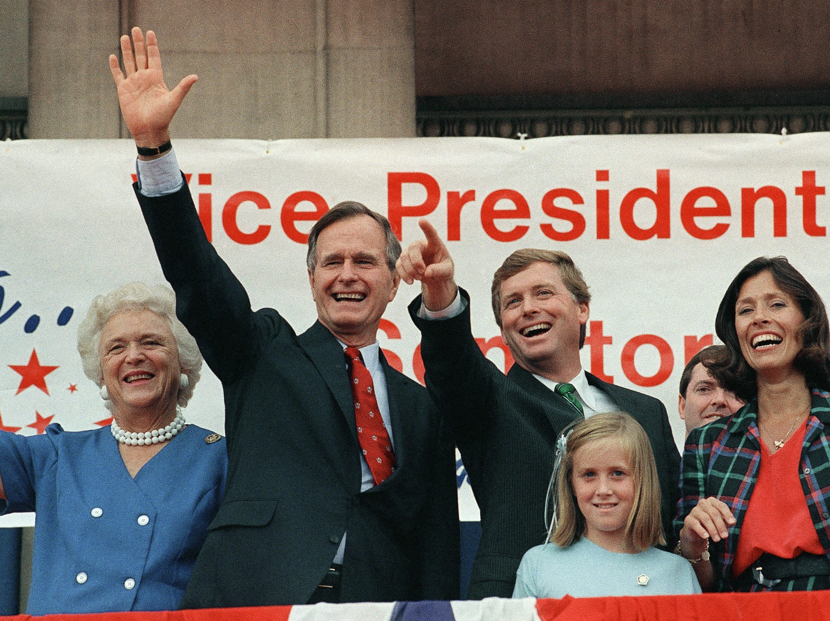 Republican presidential nominee George H.W. Bush with his wife, Barbara, left, begins the campaign with a rally in Sen. Dan Quayle's hometown of Huntington, Indiana  Friday, August 19, 1988. Quayle with his wife, Marilyn and daughter, Corinne, right, greeted supporters across the street from the newspaper Quayle published. (AP Photo/Scott Applewhite)