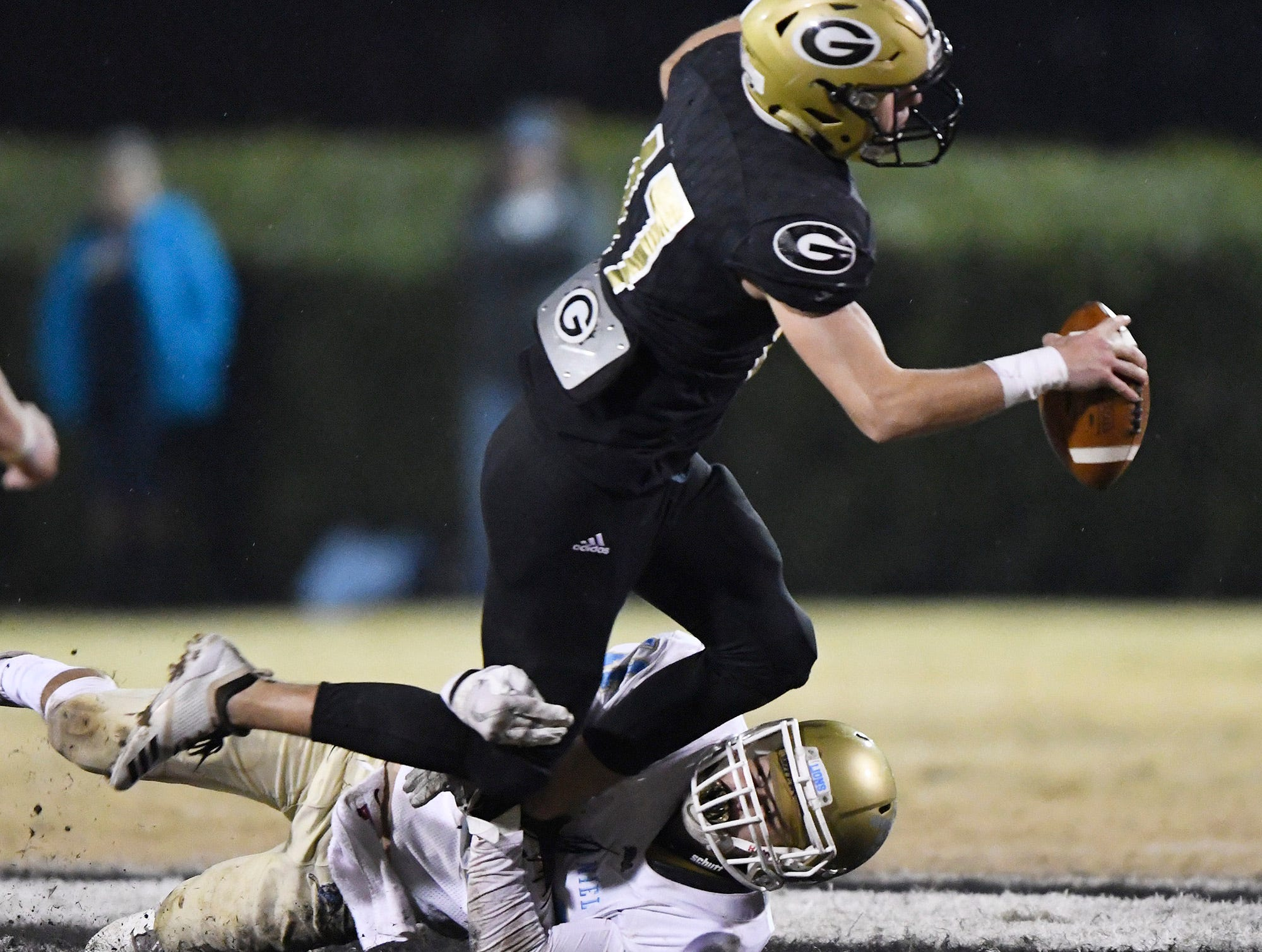 Greer quarterback Matthew Huff (17) is brought down by Daniel's Bubba McAtee (11) in the class AAAA upstate championship Friday, November 30, 2018 at Greer's Dooley Field.