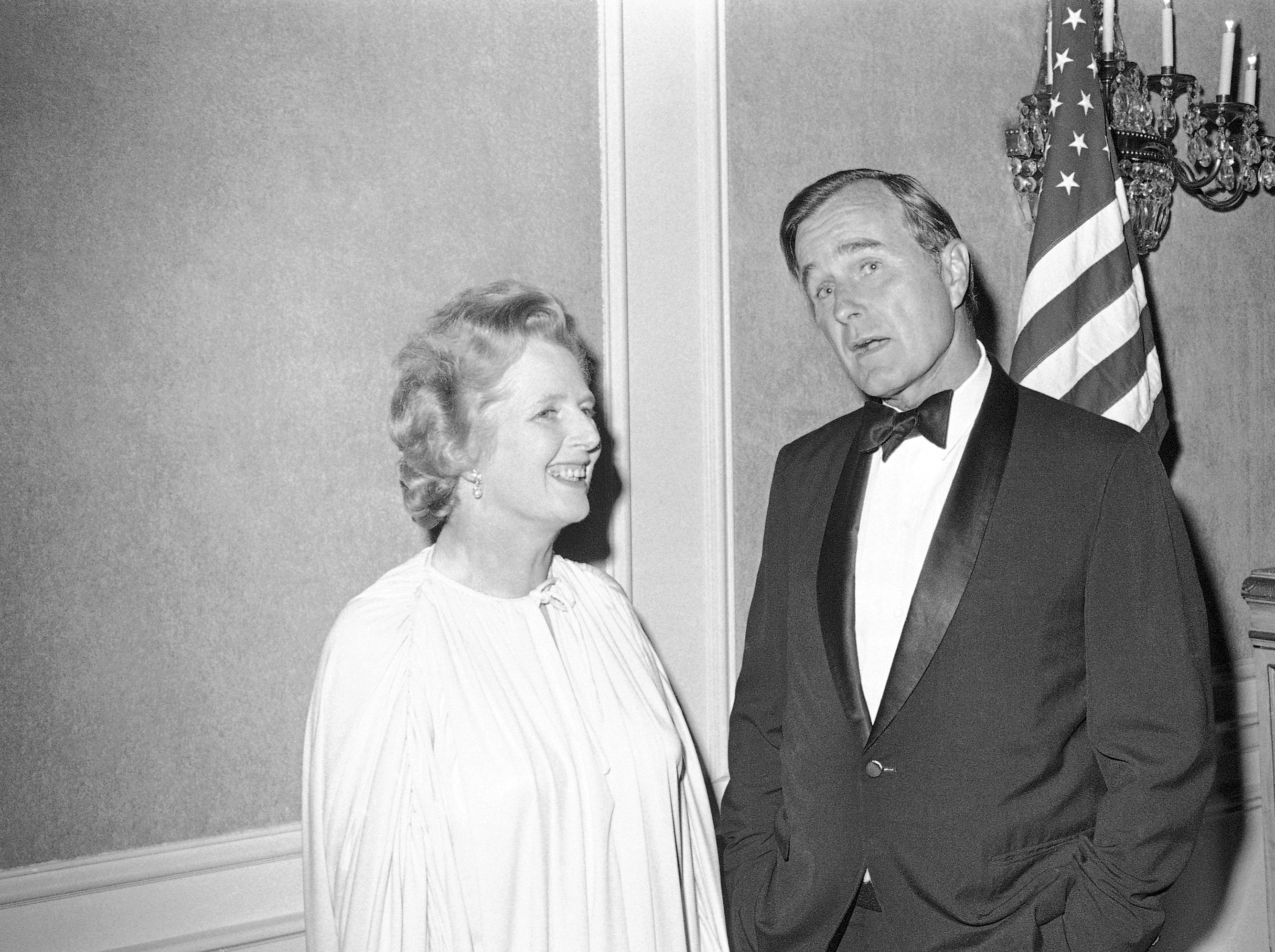 Margaret Thatcher, left, leader of the British Conservative Party, talking with George H.W. Bush, right, former CIA Director on Friday, Sept. 9, 1977 at Houston, prior to her dinner address before the English-Speaking Union.    Bush introduced her to the guests. (AP Photo/)Ed Kolenovsky)